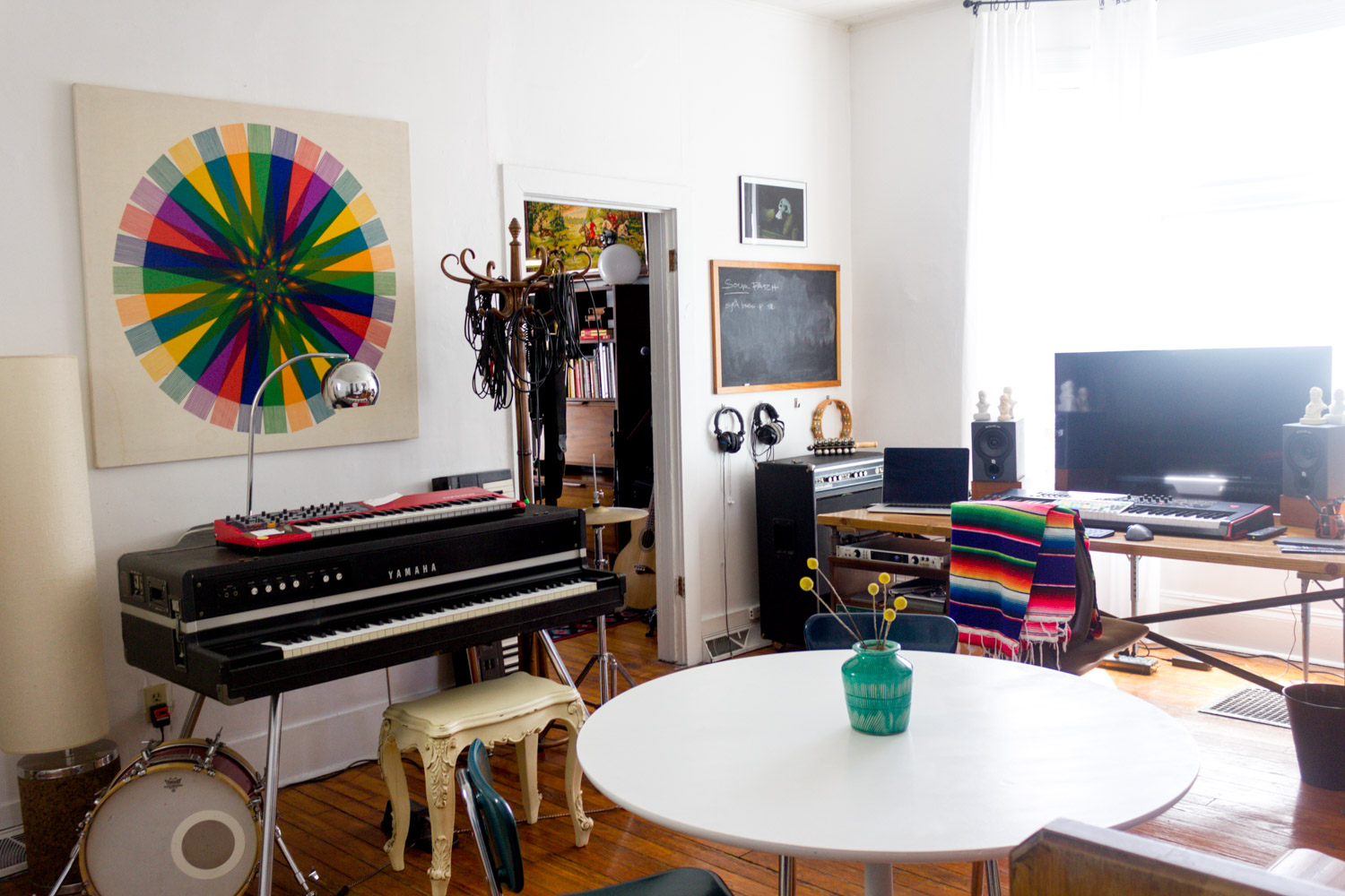 Colorful in-home music studio with vintage Yamaha CP-70 grand piano