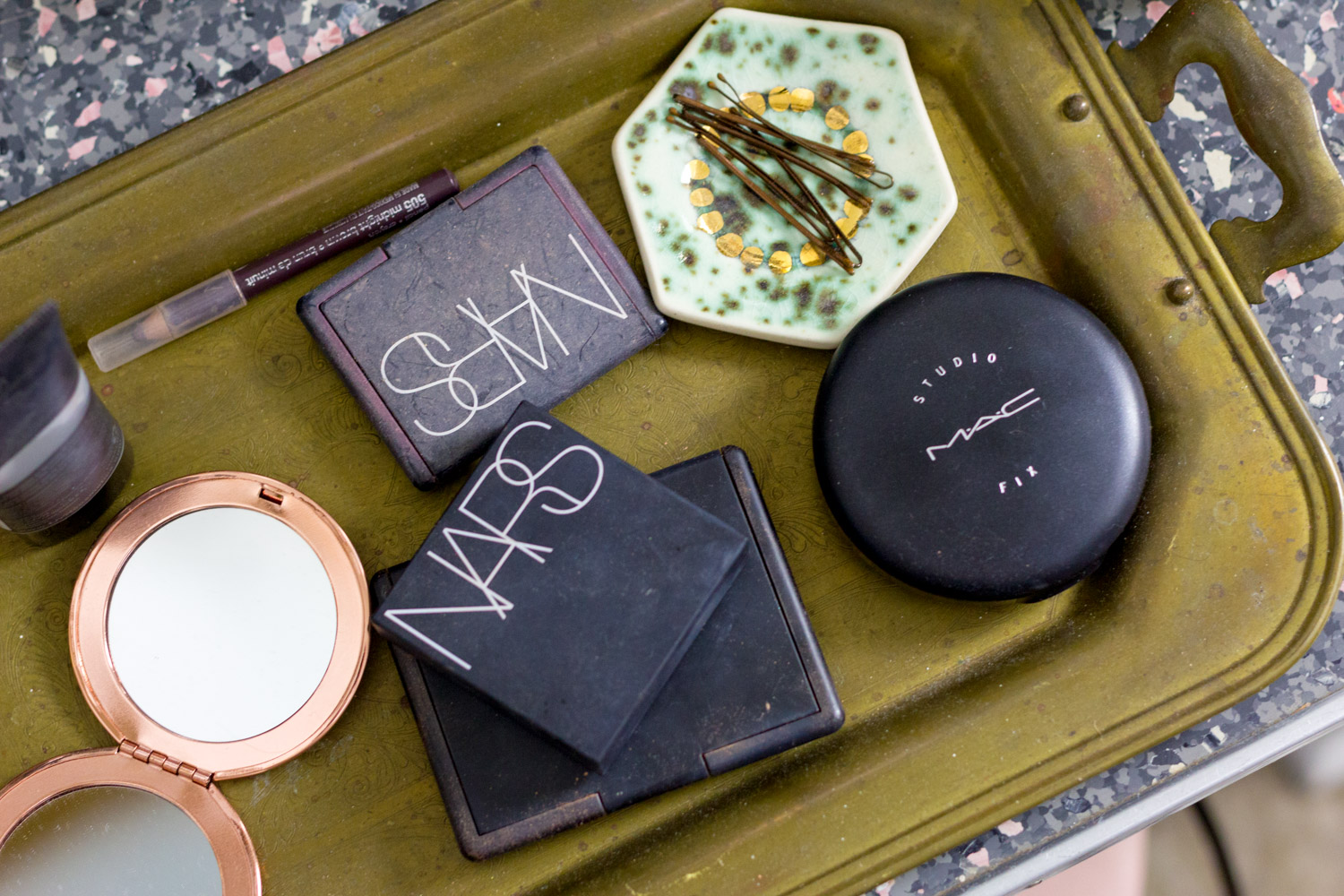 Makeup on brass tray