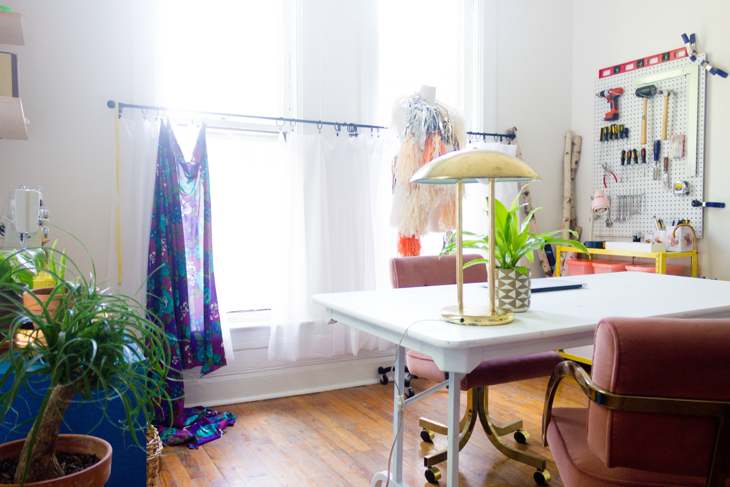 Colorful Office with Painted Peg Board and Vintage Furniture
