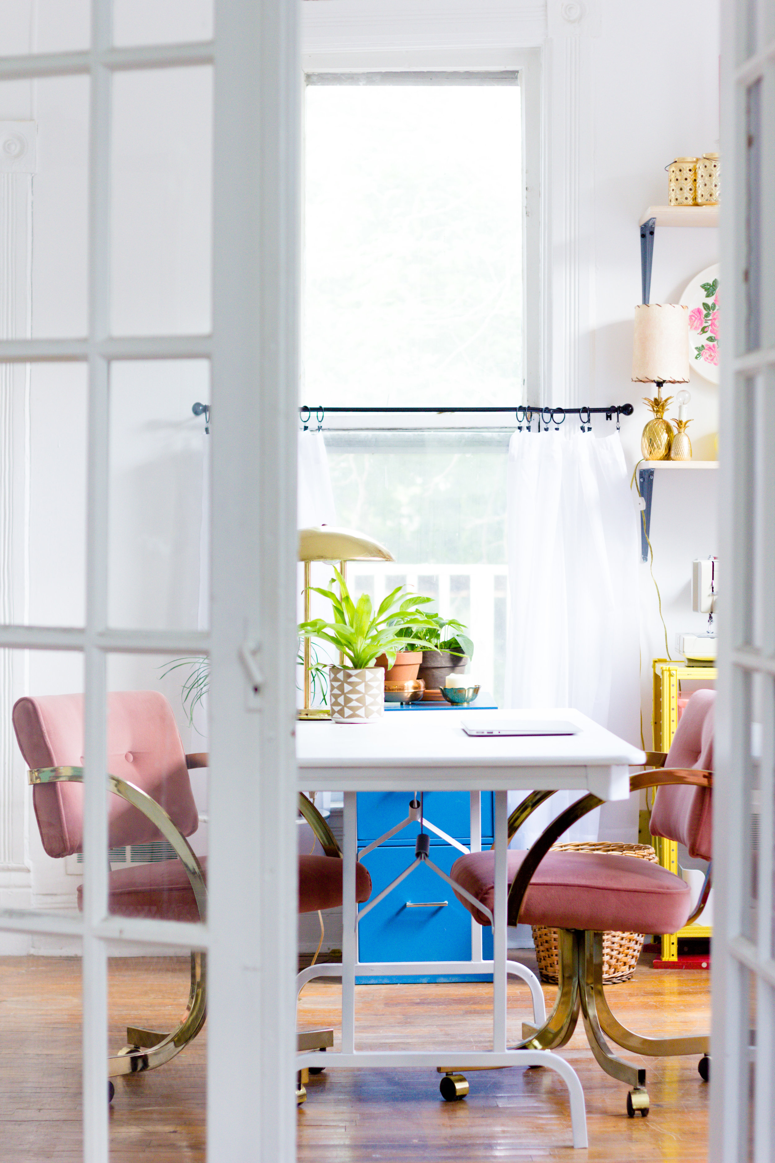 Home Office with Pink and Brass Office Chairs and French Doors