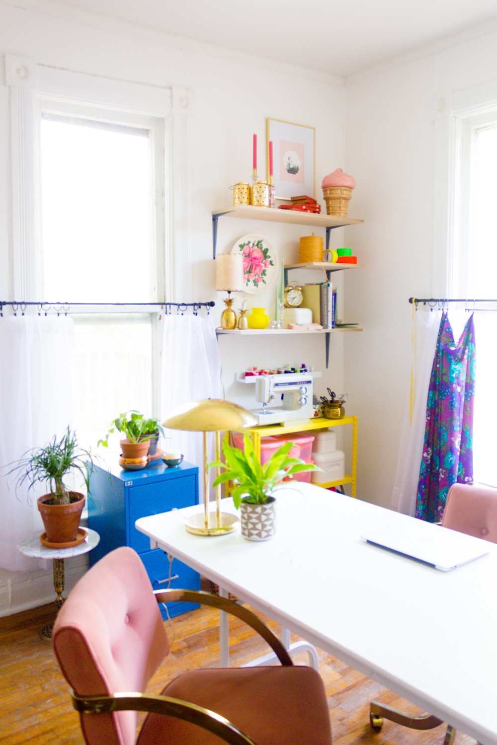 Colorful Home Office with Pink Chairs and Prop Shelves