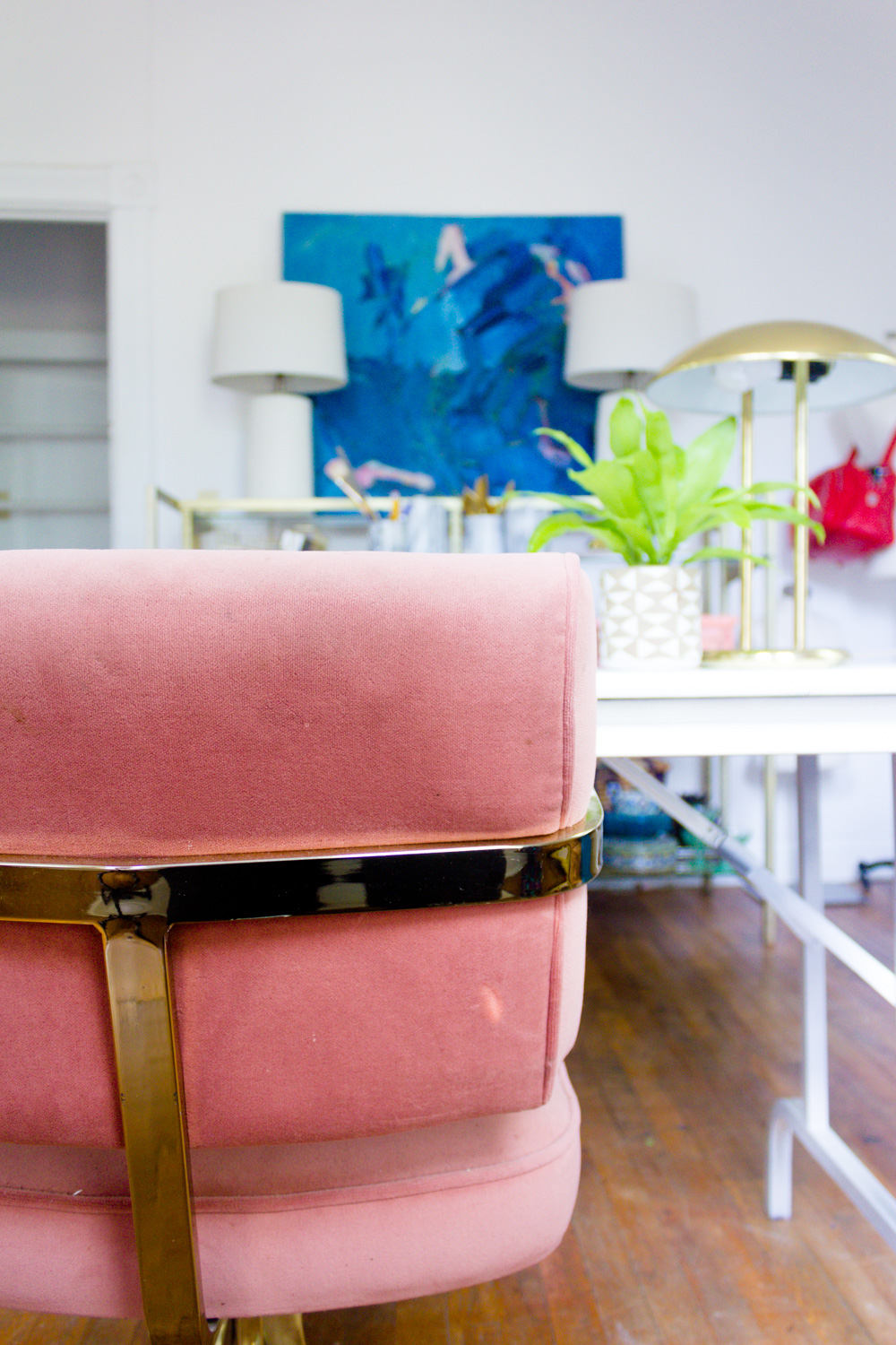 Blue Abstract Painting and PInk and Brass Office Chair