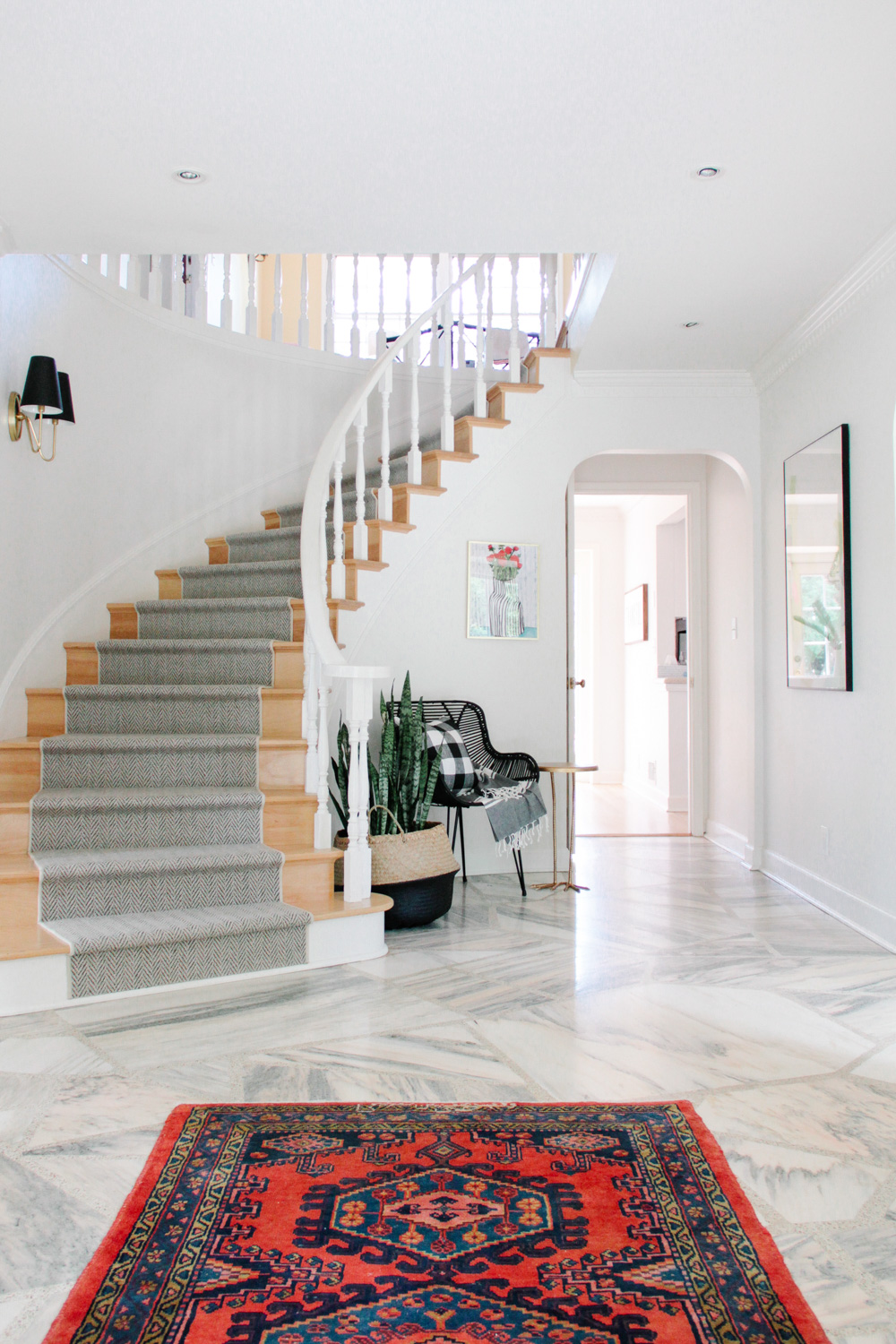 Modern Colonial Entryway with Herringbone Runner and Antique Rug