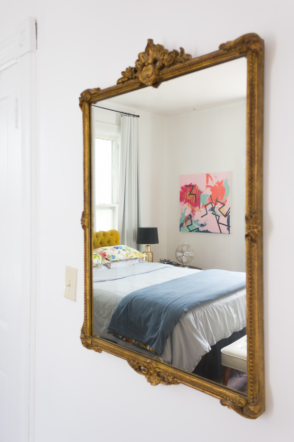 Antique Mirror in Bright and Colorful Bedroom