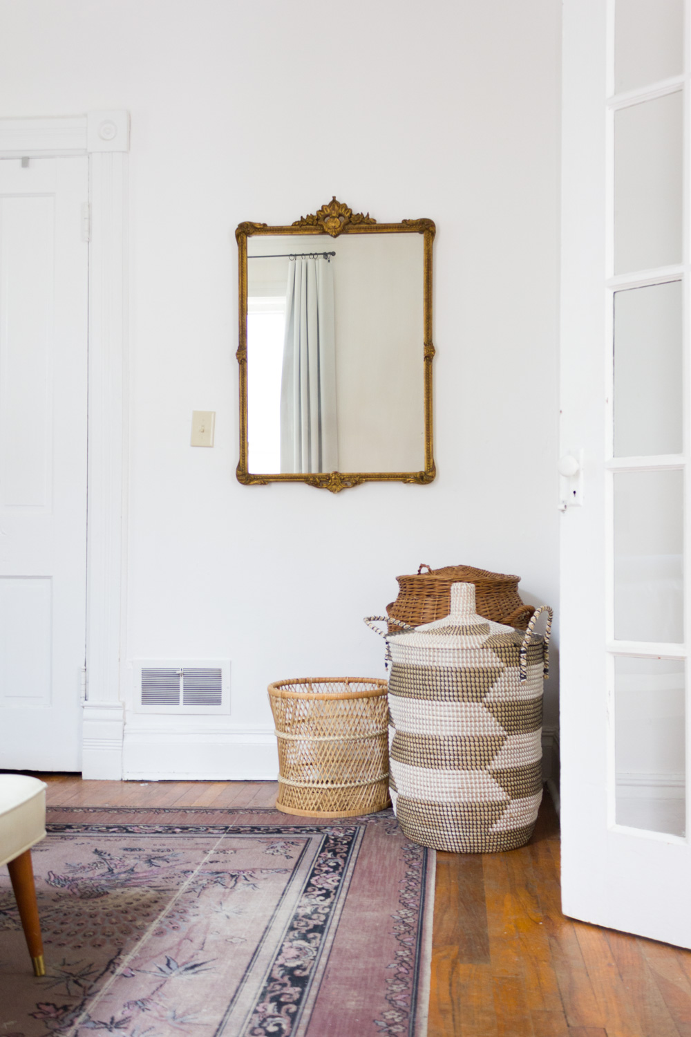 Antique Mirror and Bohemian Baskets in Bedroom