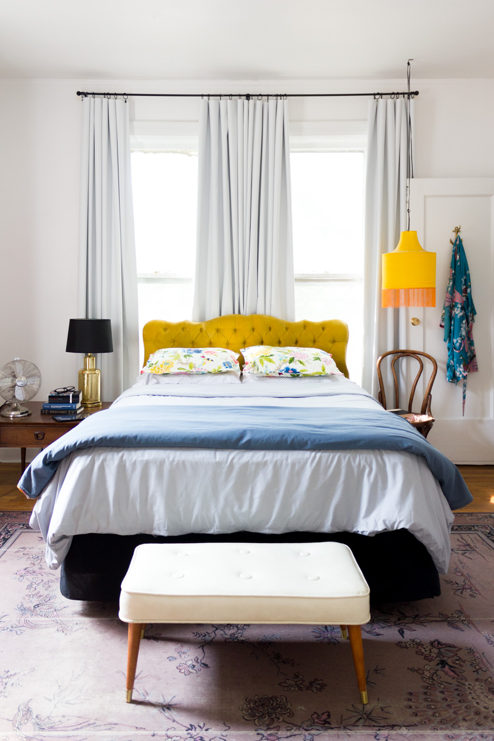 Bright and Sunny Bedroom with Gold Velvet Headboard
