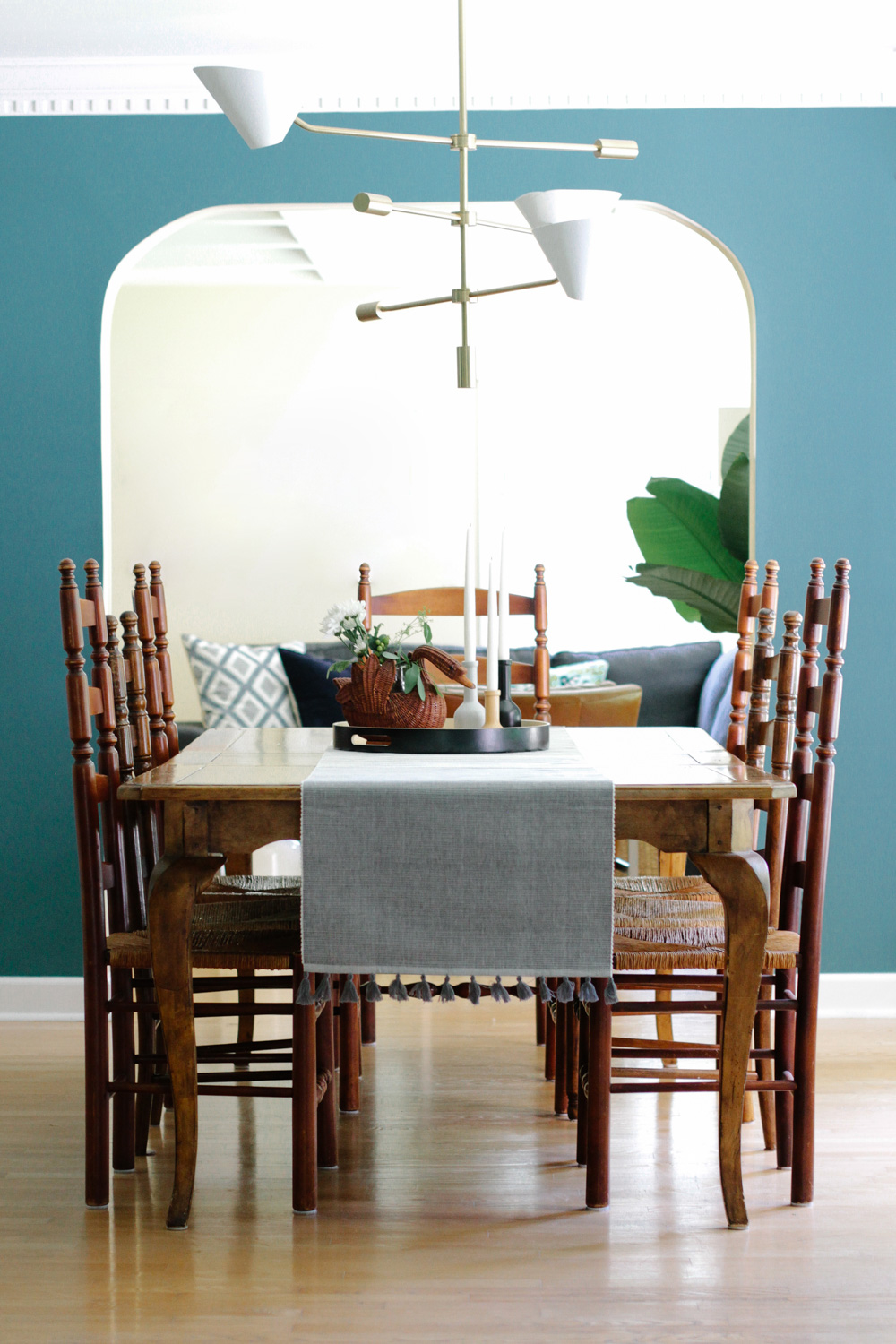 Modern Colonial Dining Room with Green Walls and West Elm Mid-century Chandelier