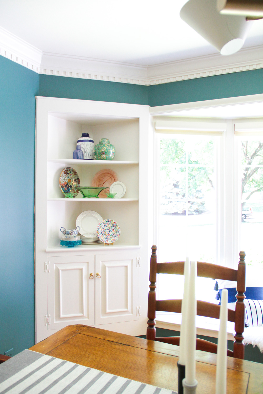Playfully Styled Corner Built-Ins in Modern Colonial Dining Room