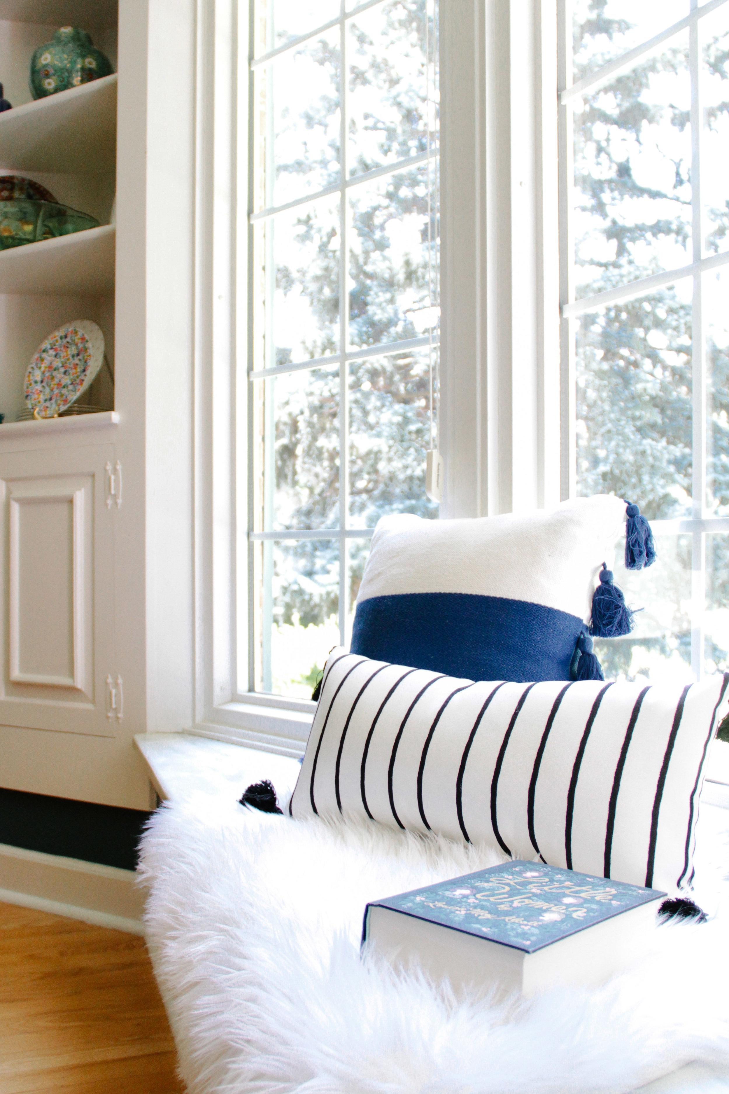 Cozy Window Seat Between Corner Built-Ins in Modern Colonial Dining Room