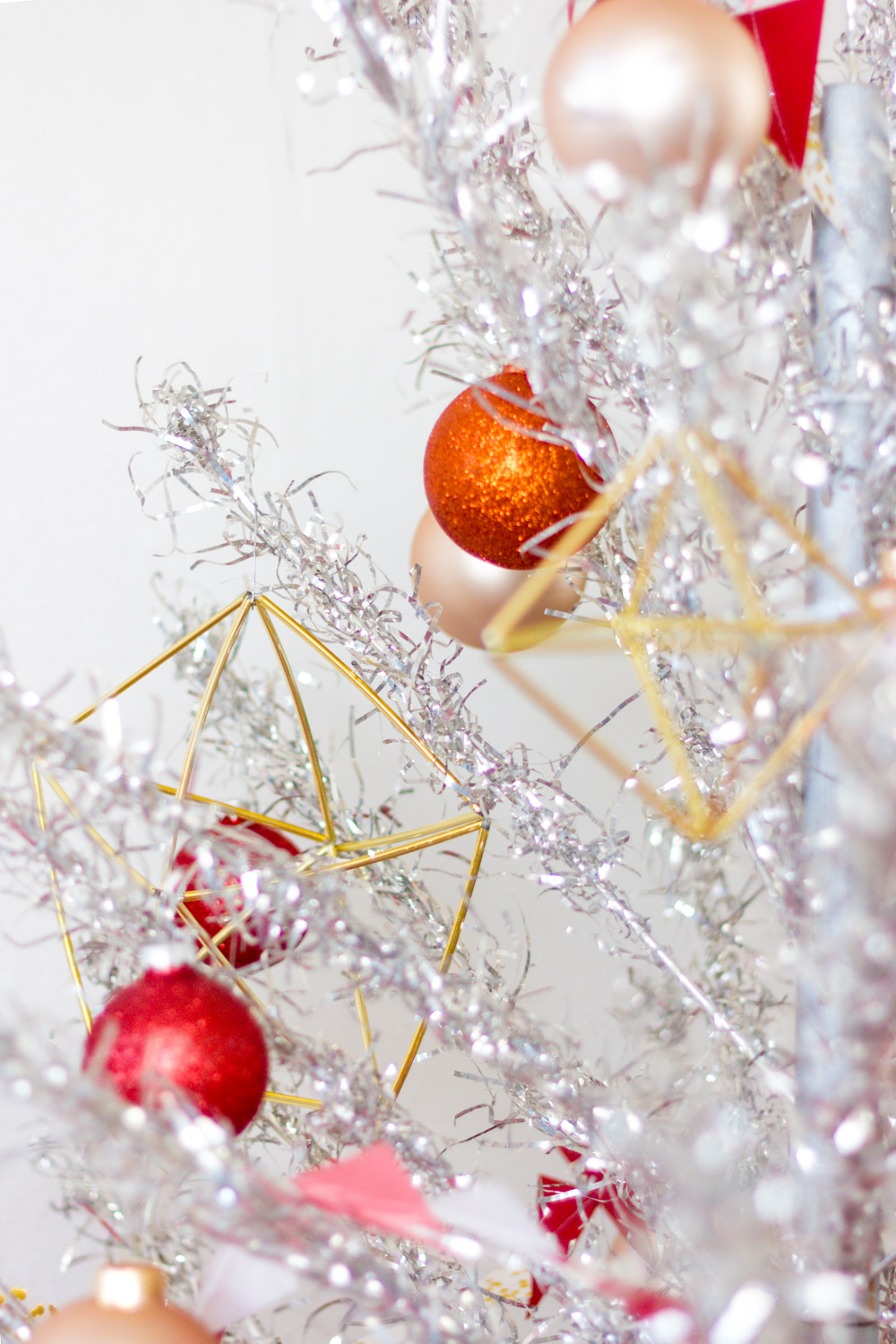 Red, Pink, and Gold Decorations on Vintage Aluminum Christmas Tree