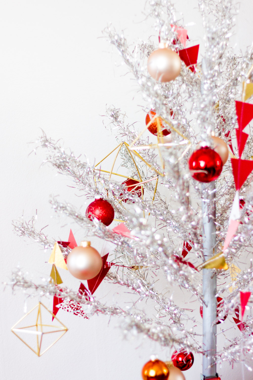 Red and Pink Decorations on Vintage Aluminum Christmas Tree