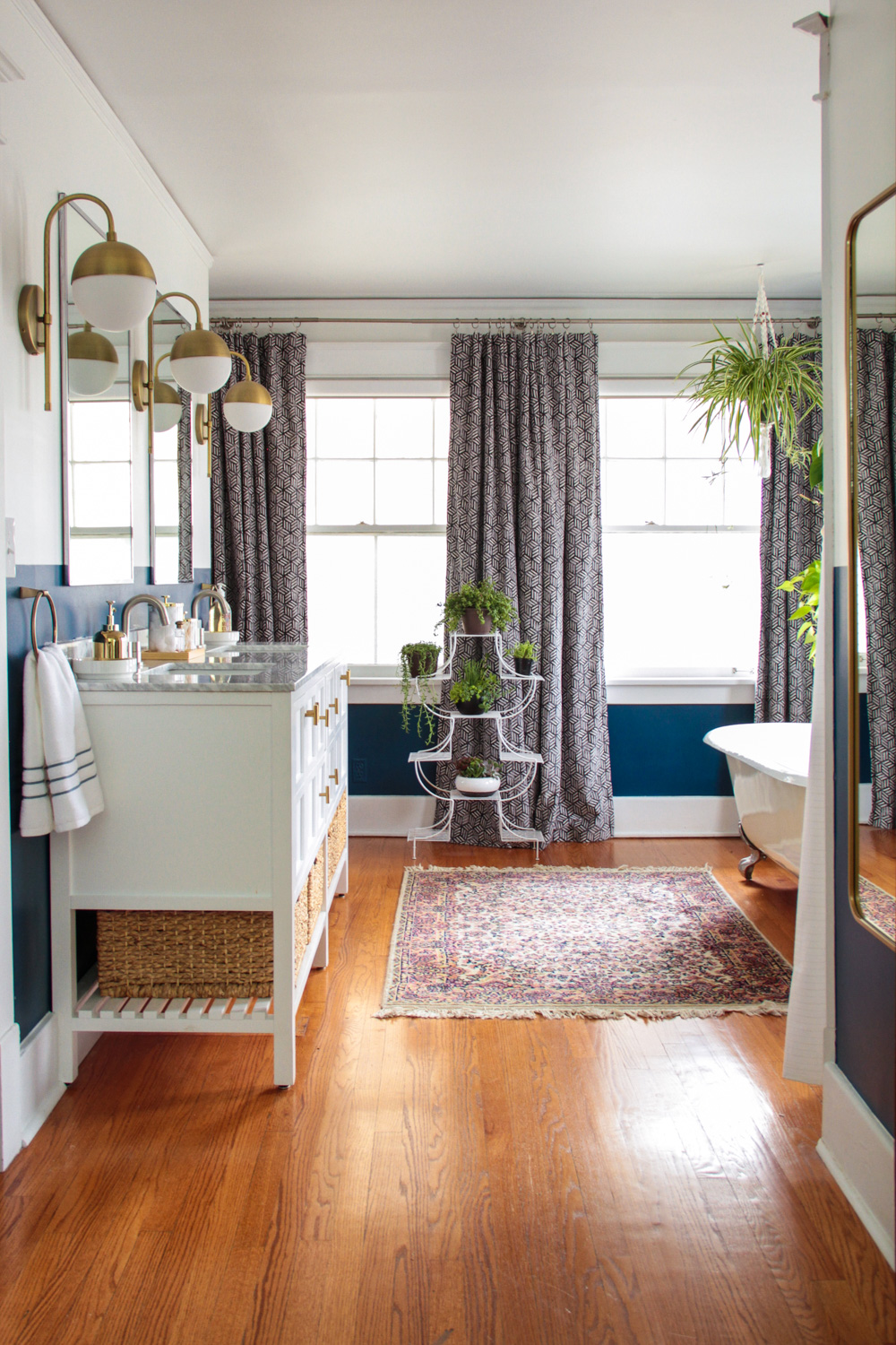 Bohemian Master Bathroom with Plants and Brass Sconces