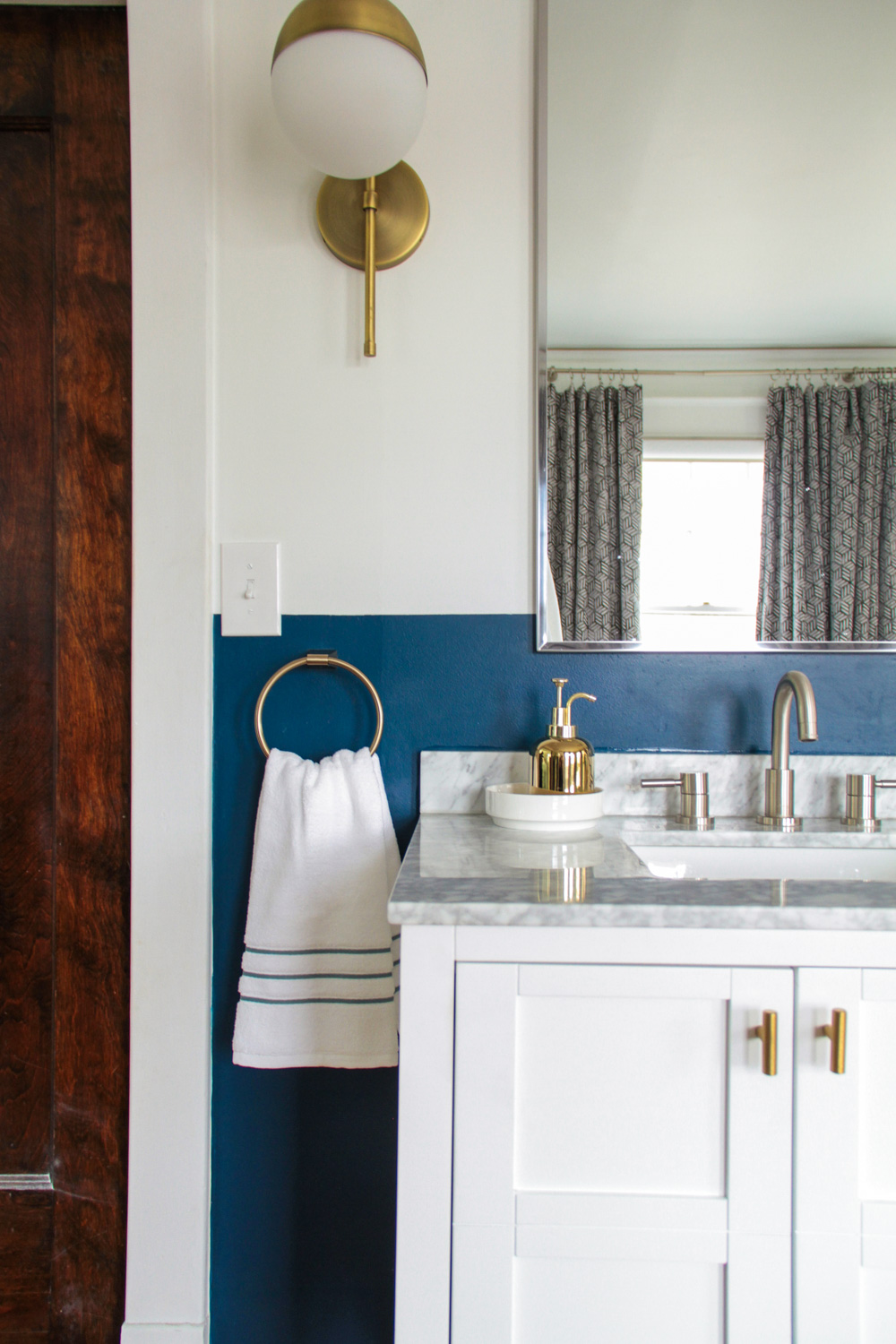 Mixed Metals in Blue and White Master Bathroom