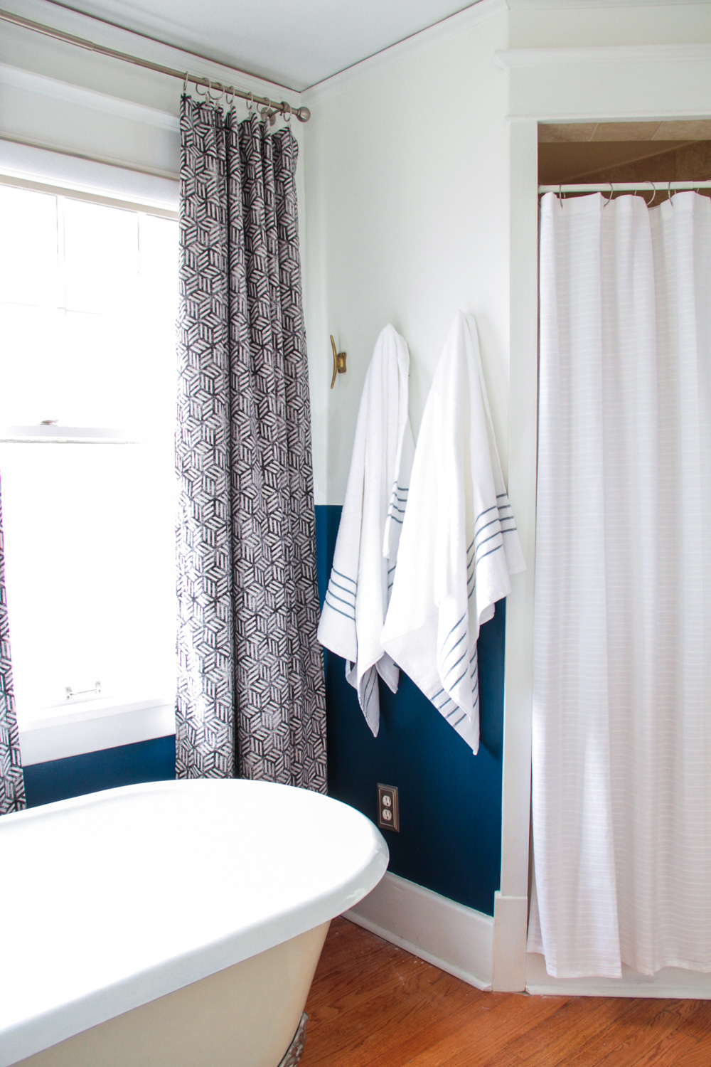 Blue and White Master Bathroom with Clawfoot Tub