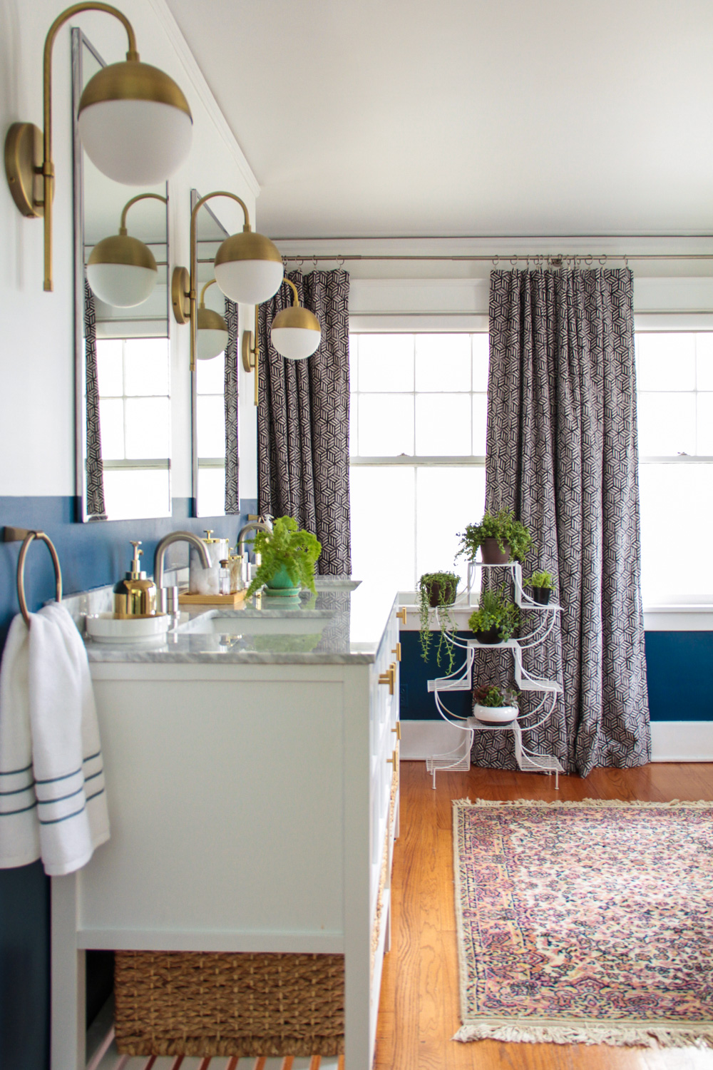 Bohemian Blue and White Master Bathroom with Brass Sconces