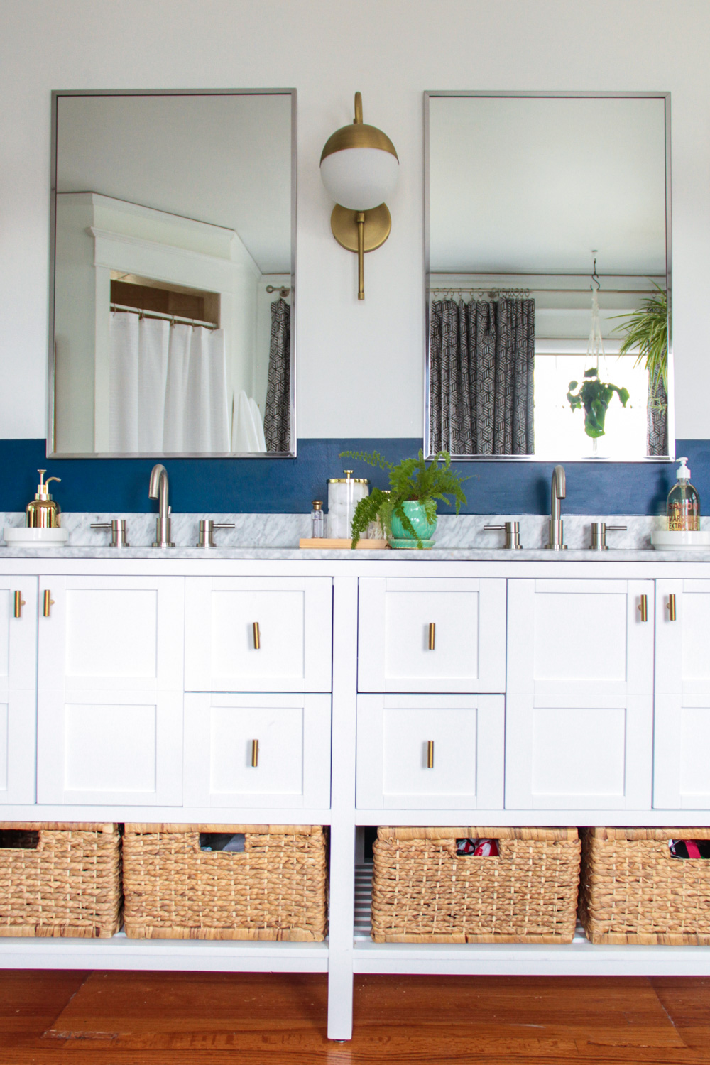 Blue and White Master Bathroom Vanity with Brass Sconces