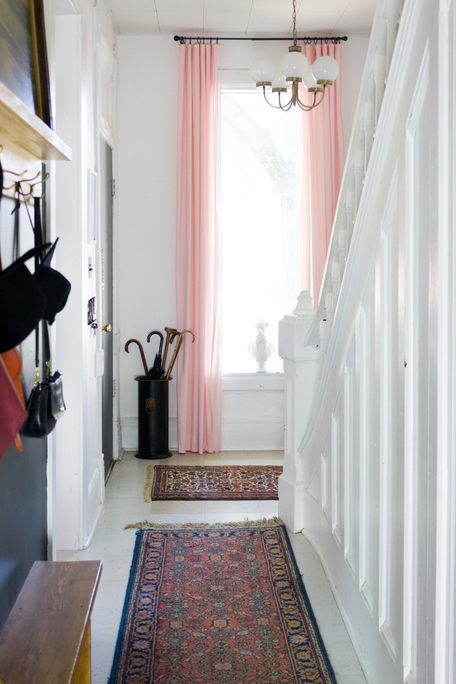 Copy of Entryway with Pink Curtains, Vintage Runner Rug, and Brass Mid Century Chandelier