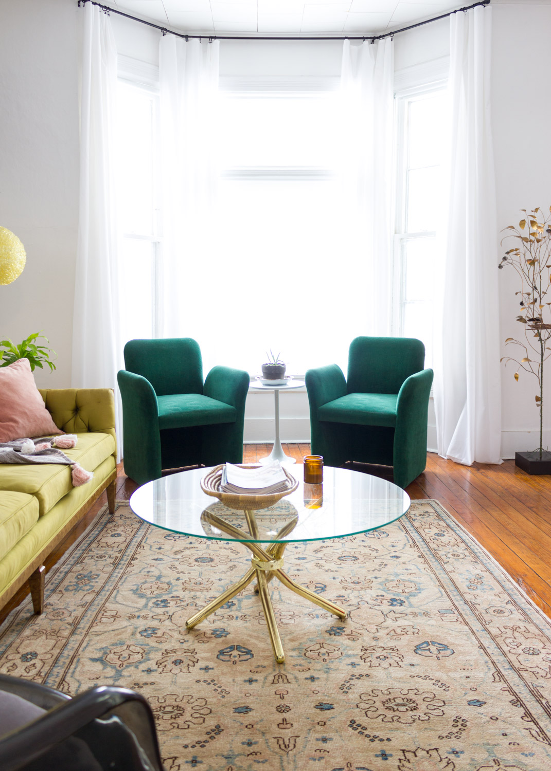 Victorian modern living room with green vintage 1980s chairs