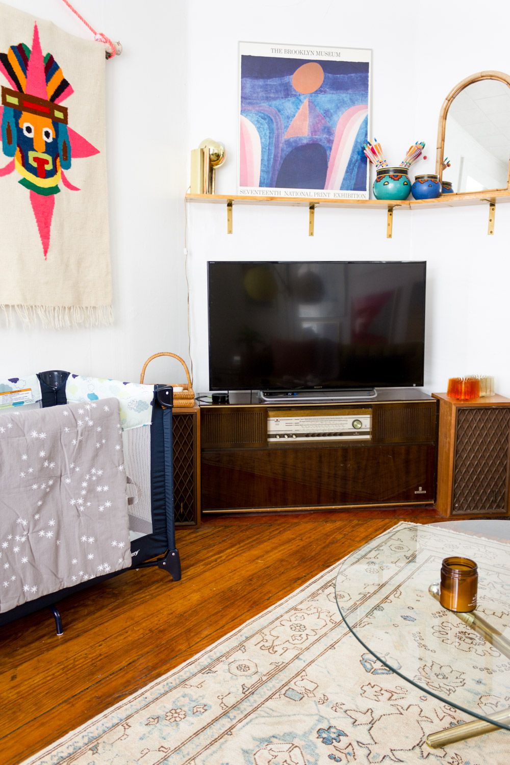 Colorful living room art with mid century tv stand