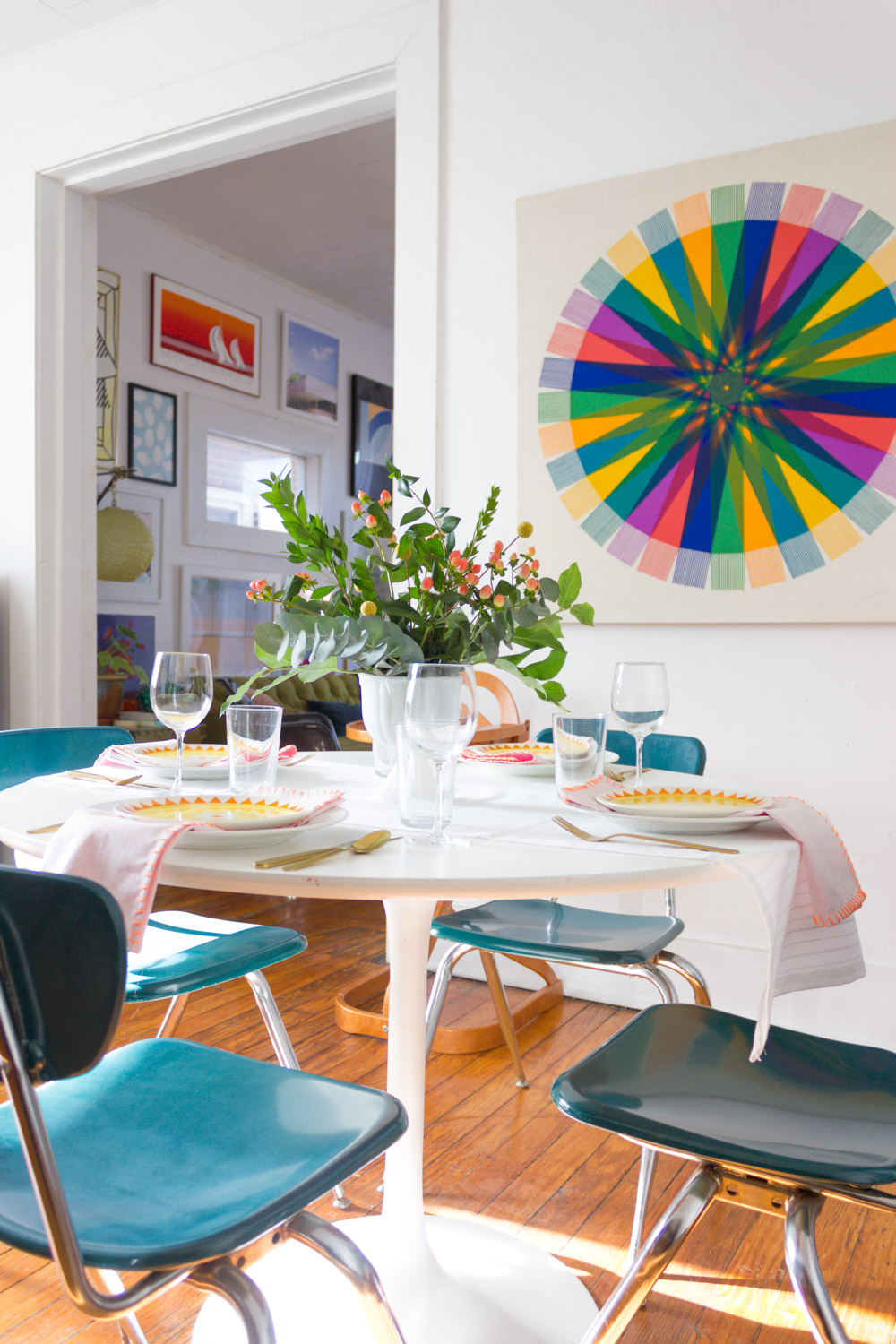 Bright and modern Thanksgiving table setting, Dining Room with vintage art
