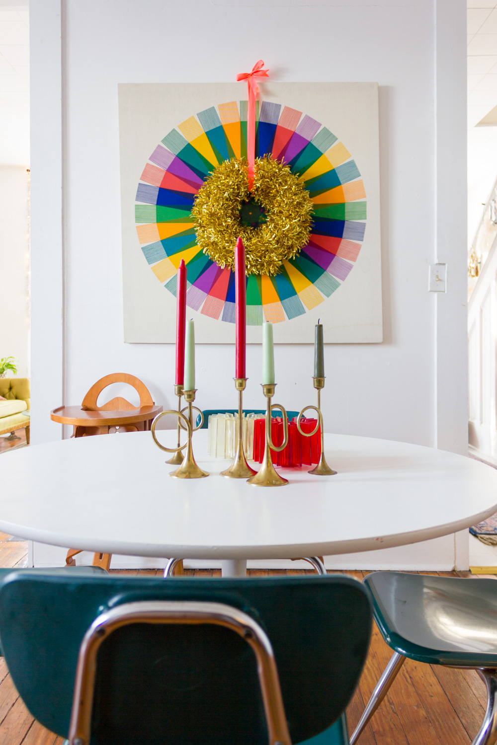 dining room with gold tinsel wreath on colorful modern art