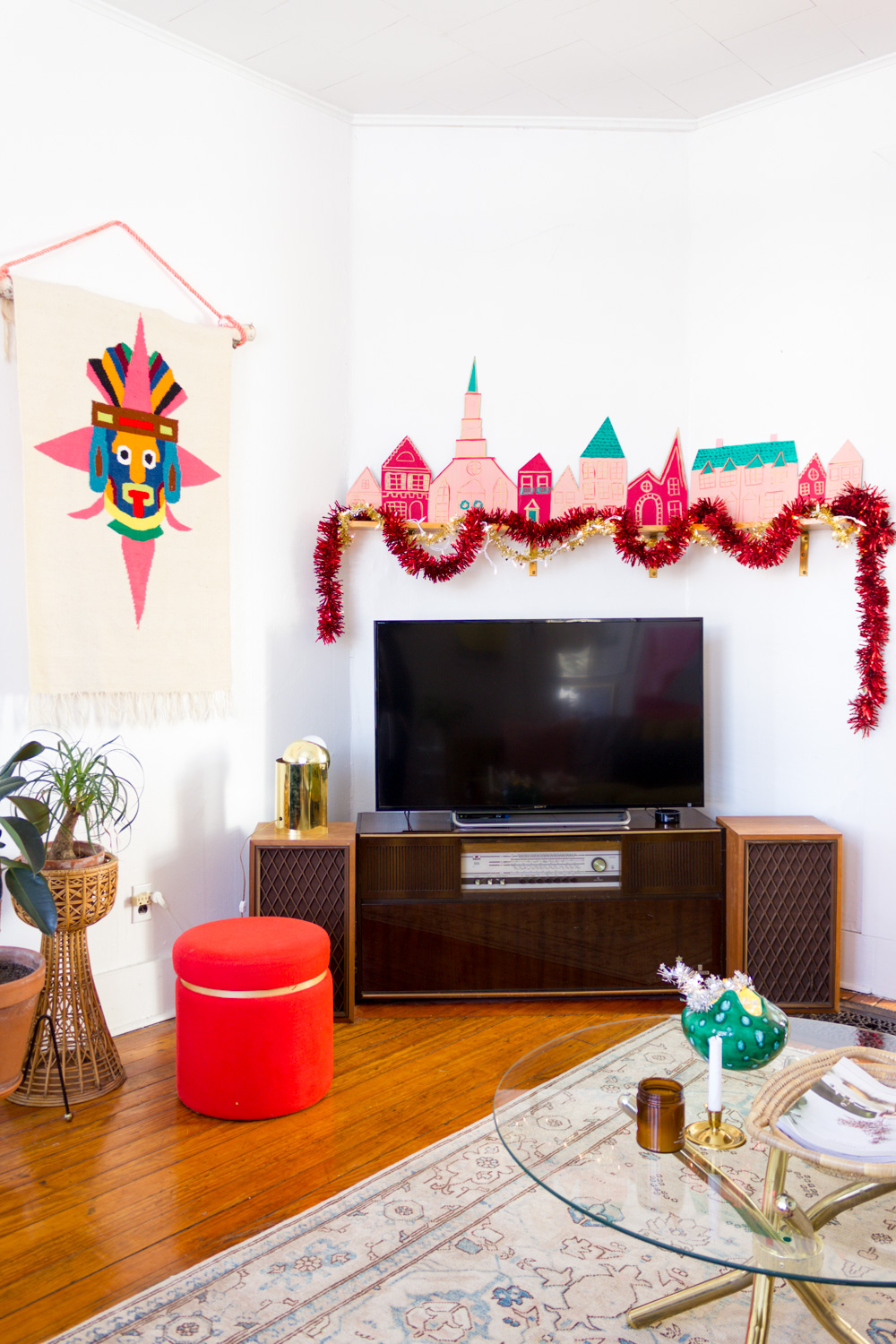 living room with DIY pink and red painted Christmas village