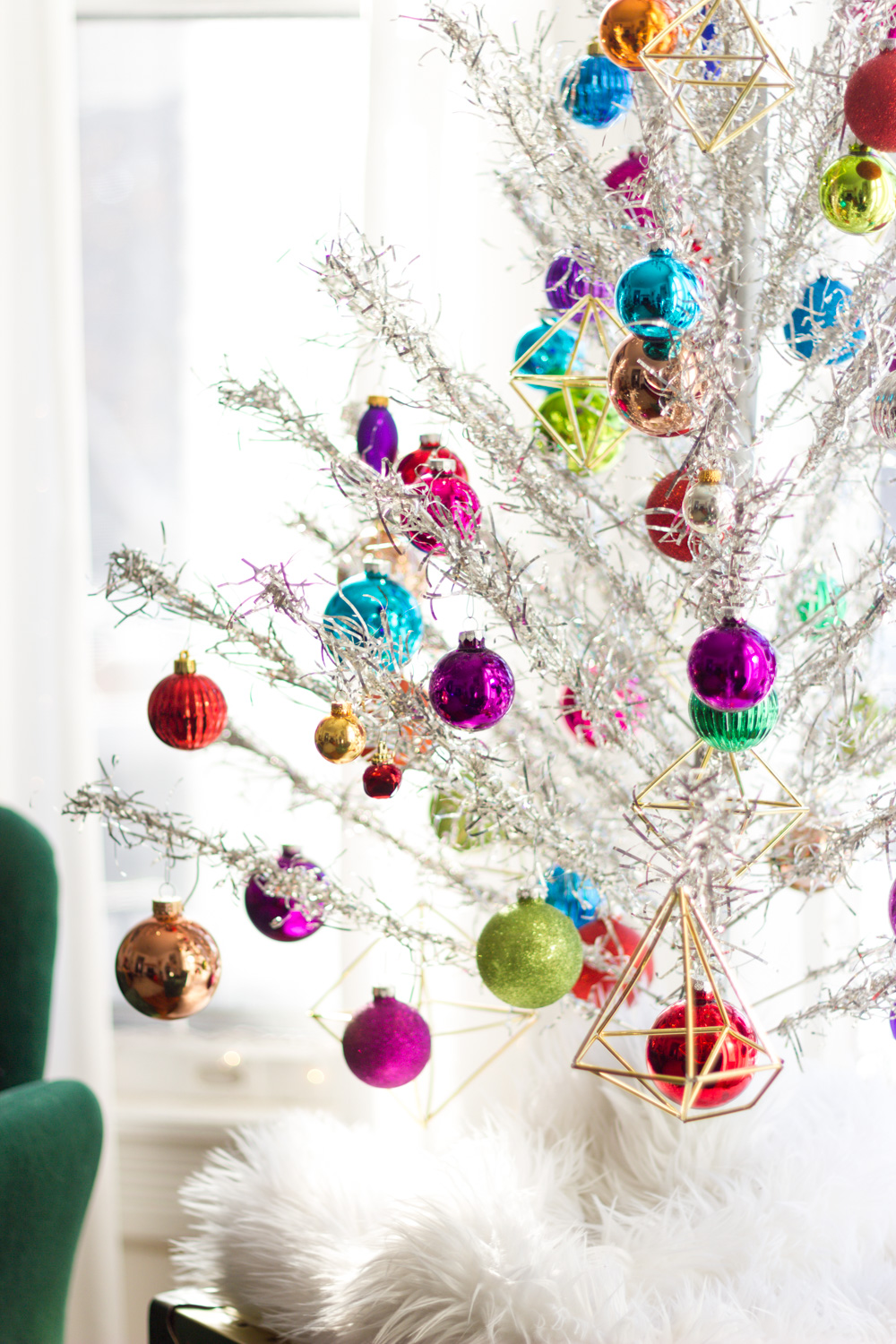 vintage silver aluminum Christmas tree with colorful ornaments