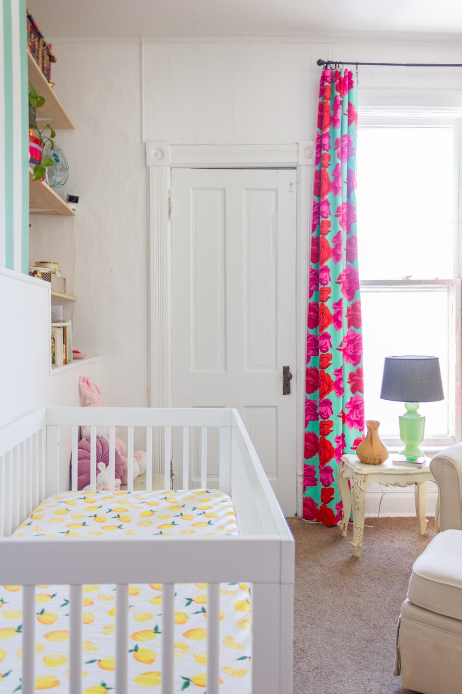 Copy of Colorful, pattern-filled nursery, DIY rose-print curtains, white modern crib