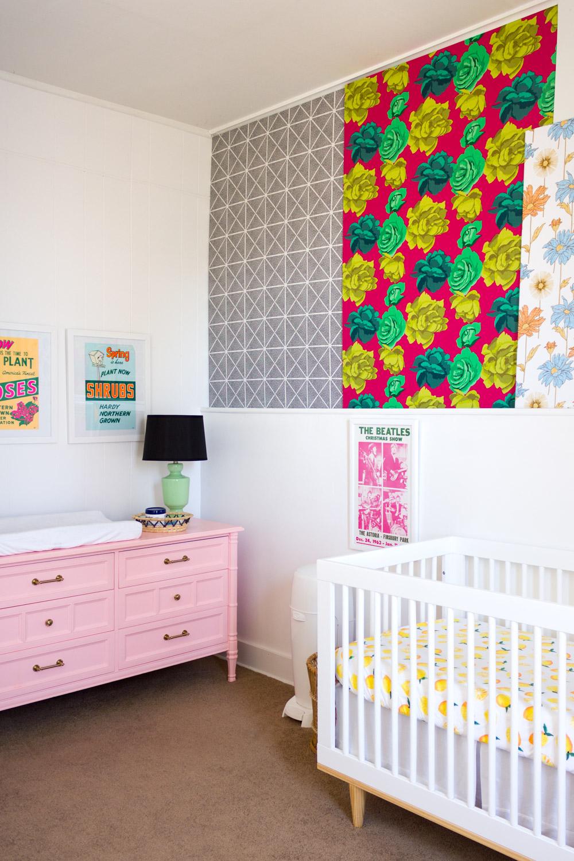 Copy of Colorful, pattern-filled nursery, peach painted dresser, rose-print panel, modern crib