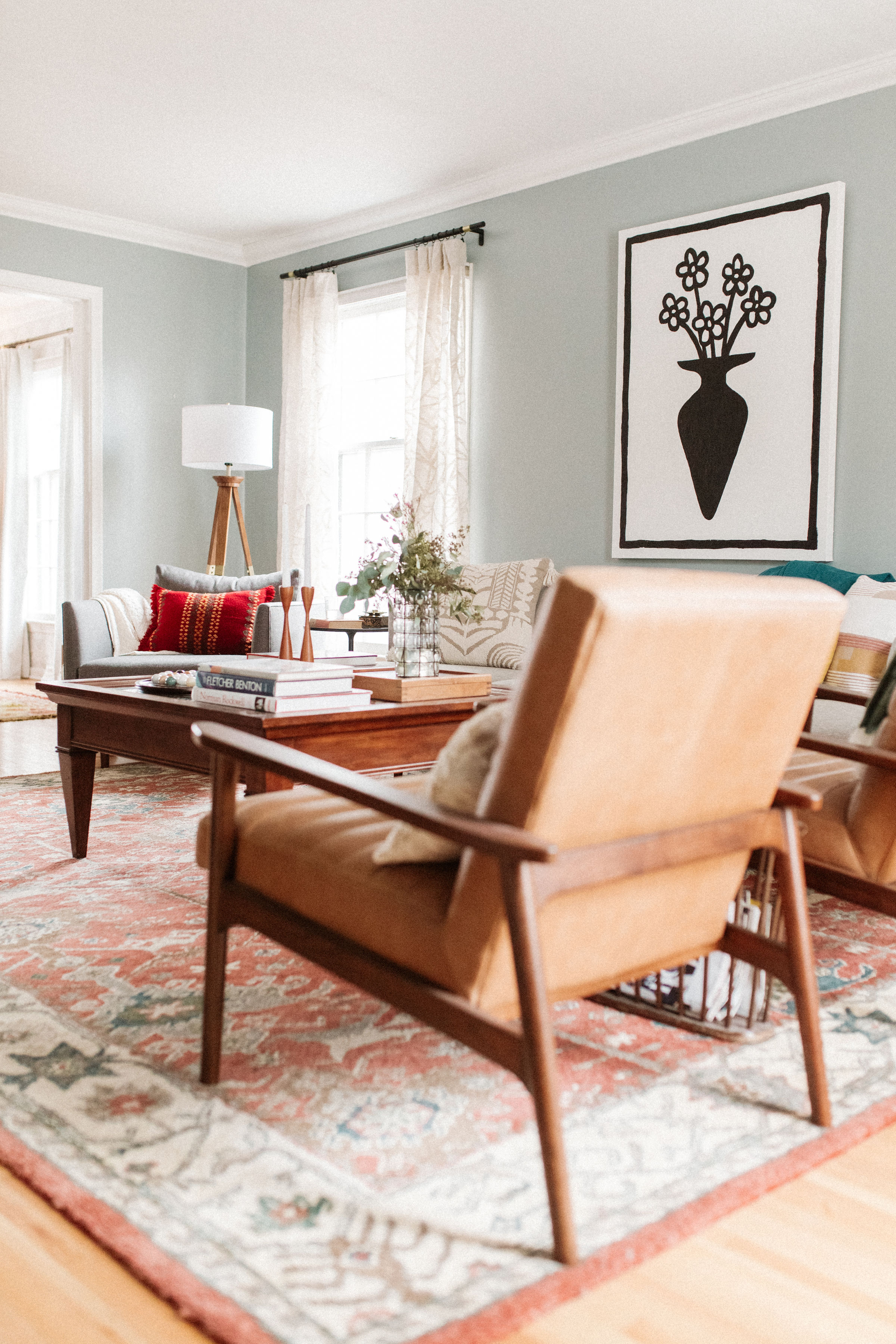 Midcentury traditional living room, warm muted colors, pop art, leather chairs