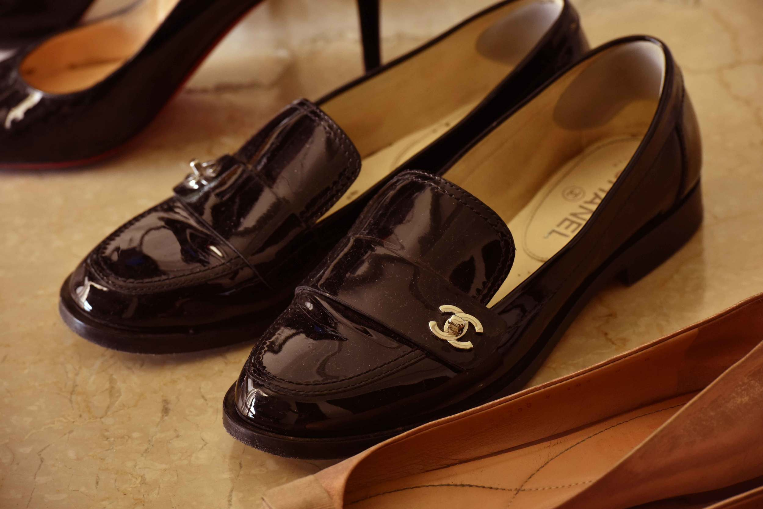 Ferragamo ballet flats, Chanel loafers and Loubitons. Image©gunjanvirk