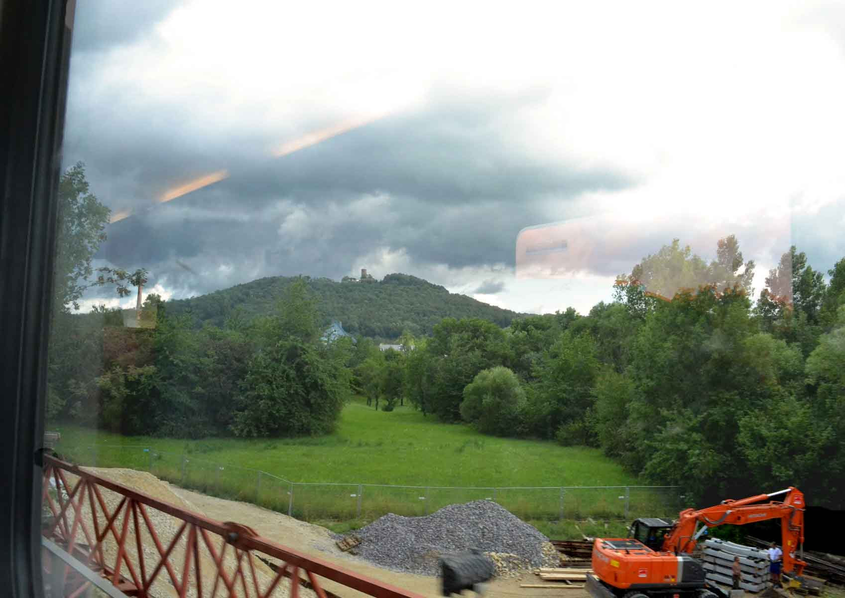 Watching construction work from train window while traveling in Germany. Image©gunjanvirk