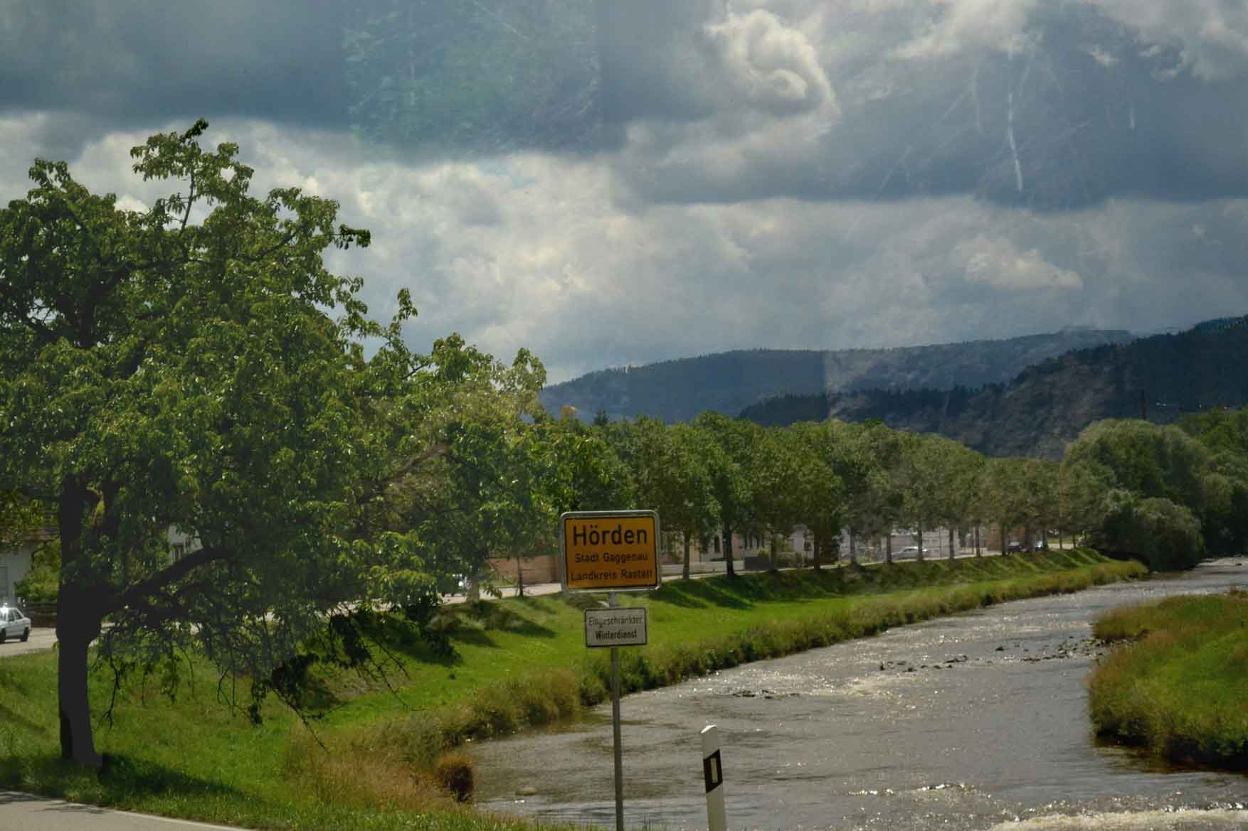 A river flows along the train ride, Germany by train. Image©gunjanvirk