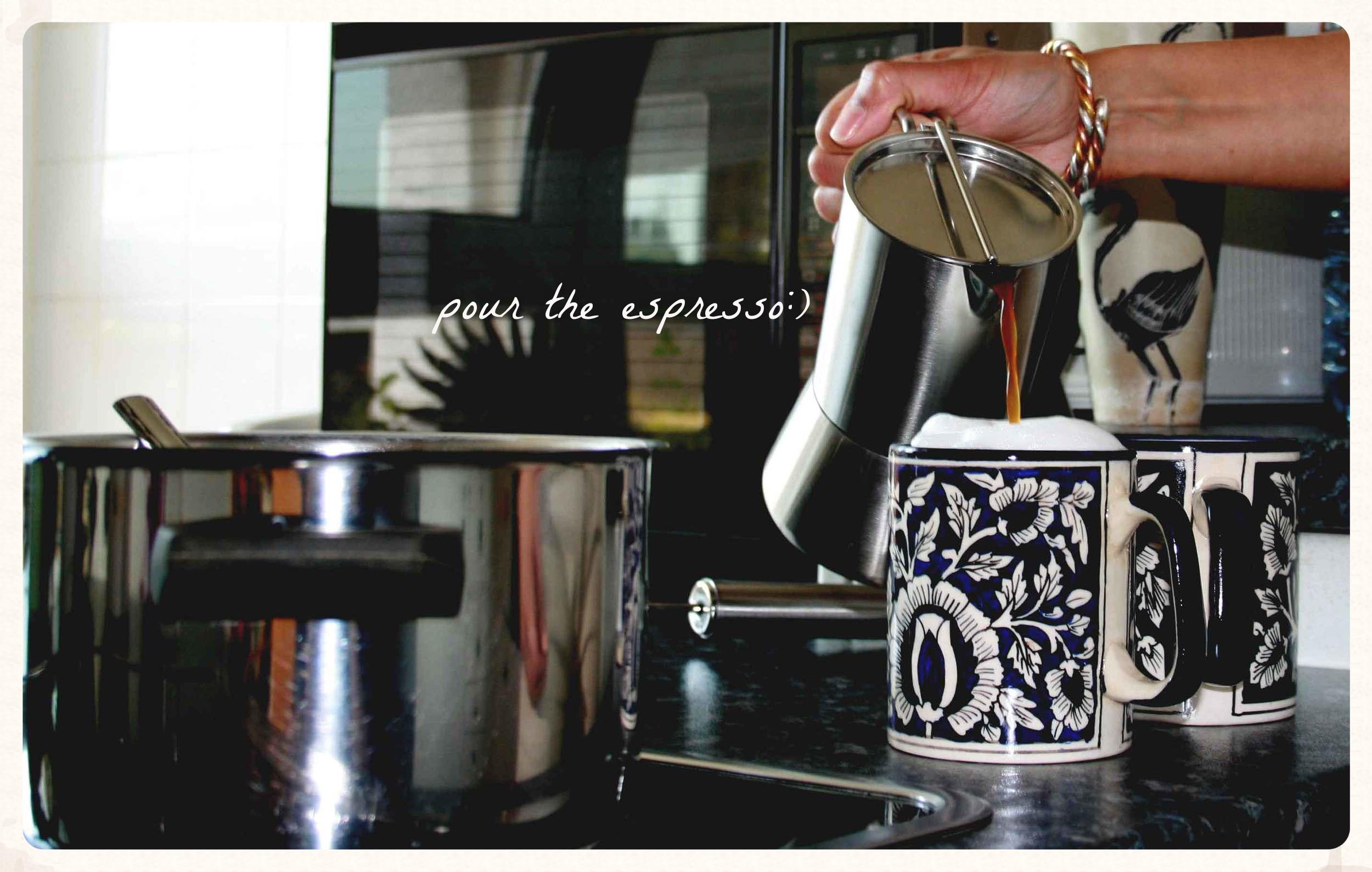 Adding espresso to milk and froth for a perfect cappuccino. Image©gunjanvirk