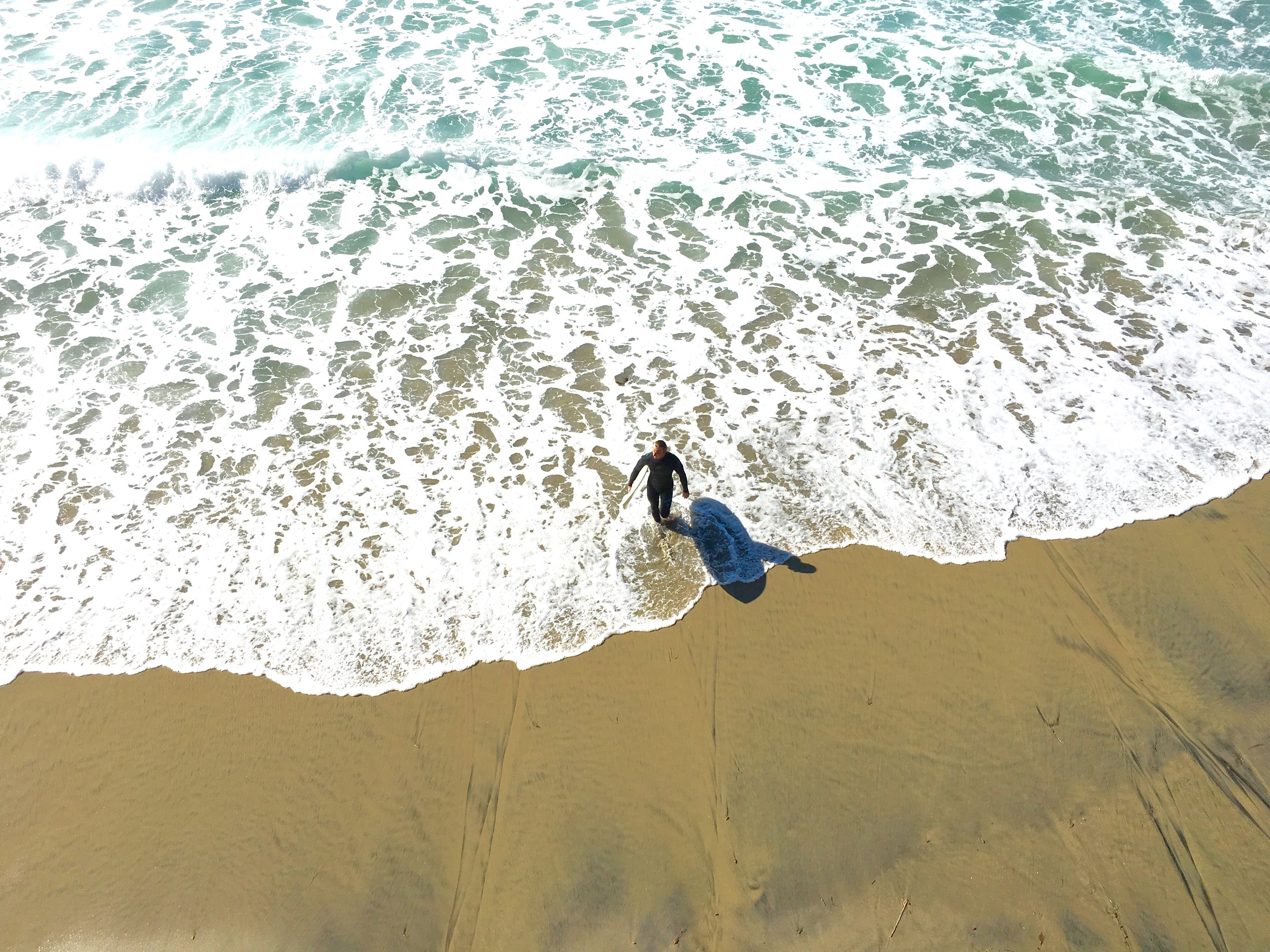 A surfer getting ready to take the plunge! Image©gunjanvirk, camera iPhone 6s Plus