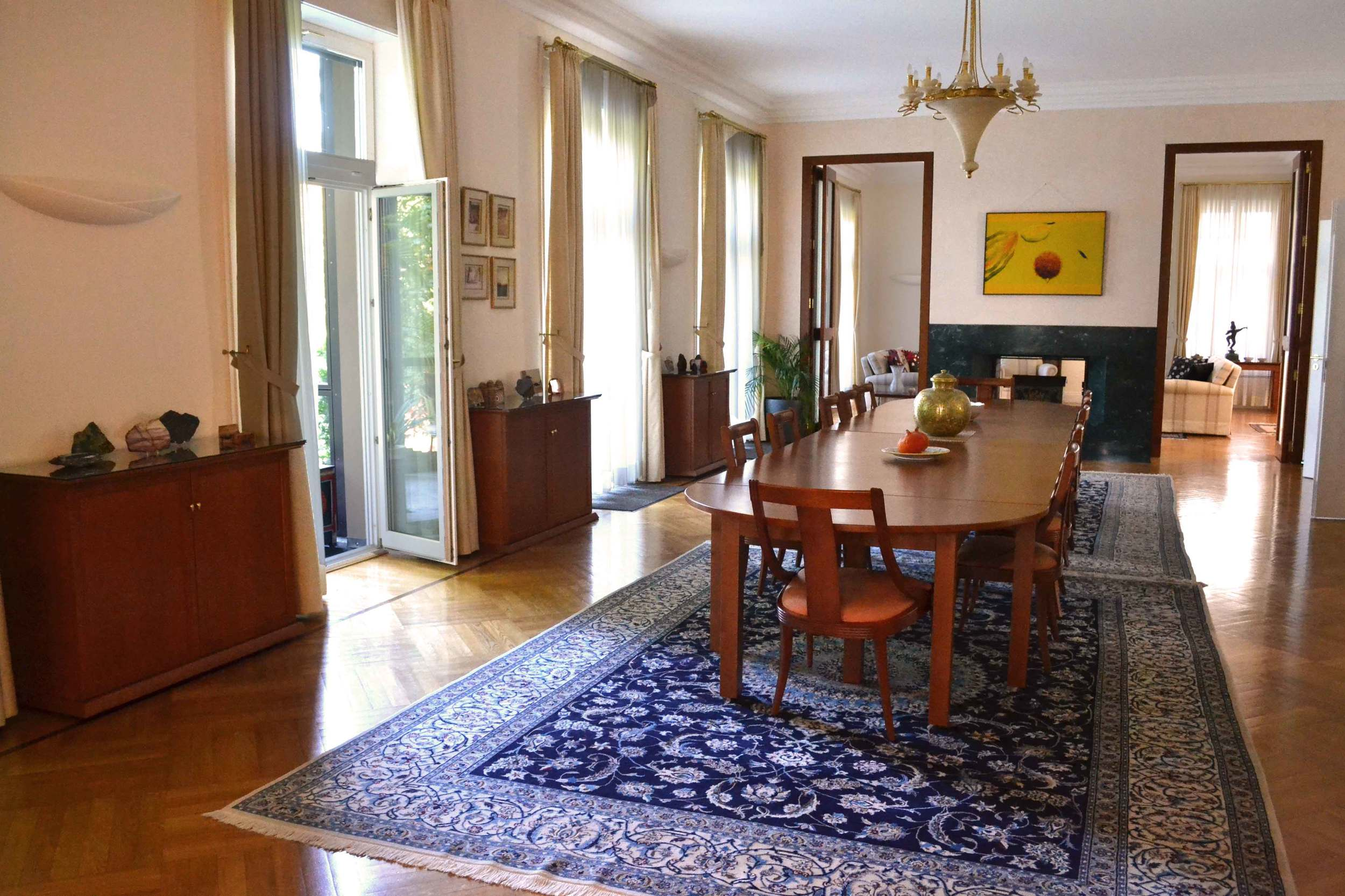 The formal dining room with glass doors opens on the lawn. Image©gunjanvirk