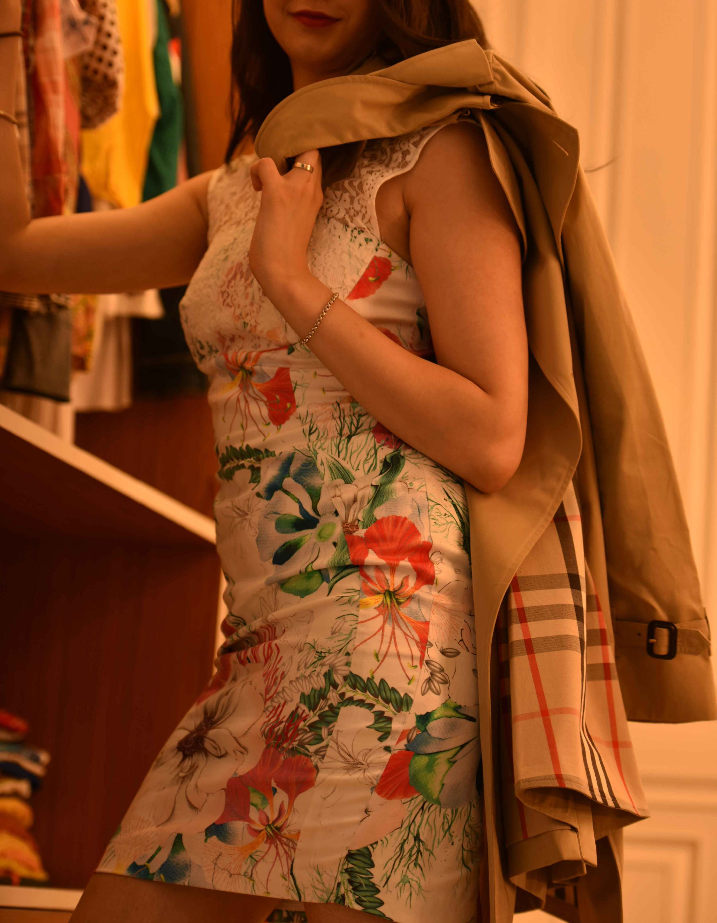 A floral printed sheath dress, a classic Burberry trench coat. Image©sourcingstyle.com