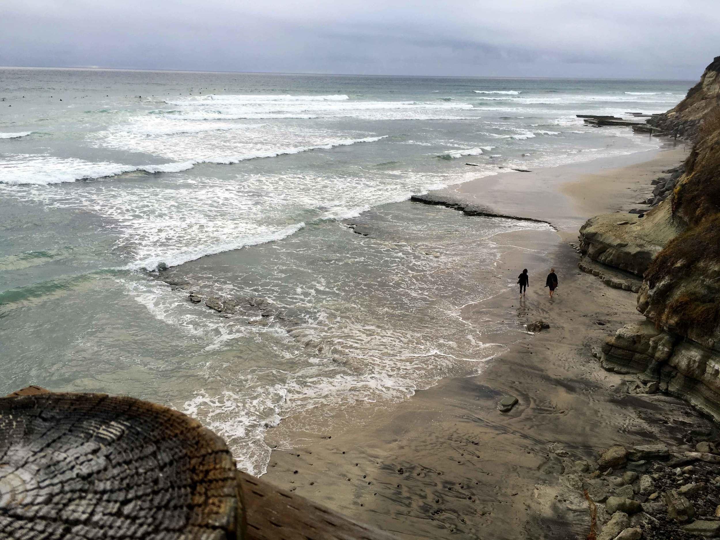 Surfers, stormy day at the ocean, ocean view, Swamis beach, Encinitas, California. Image©sourcingstyle.com