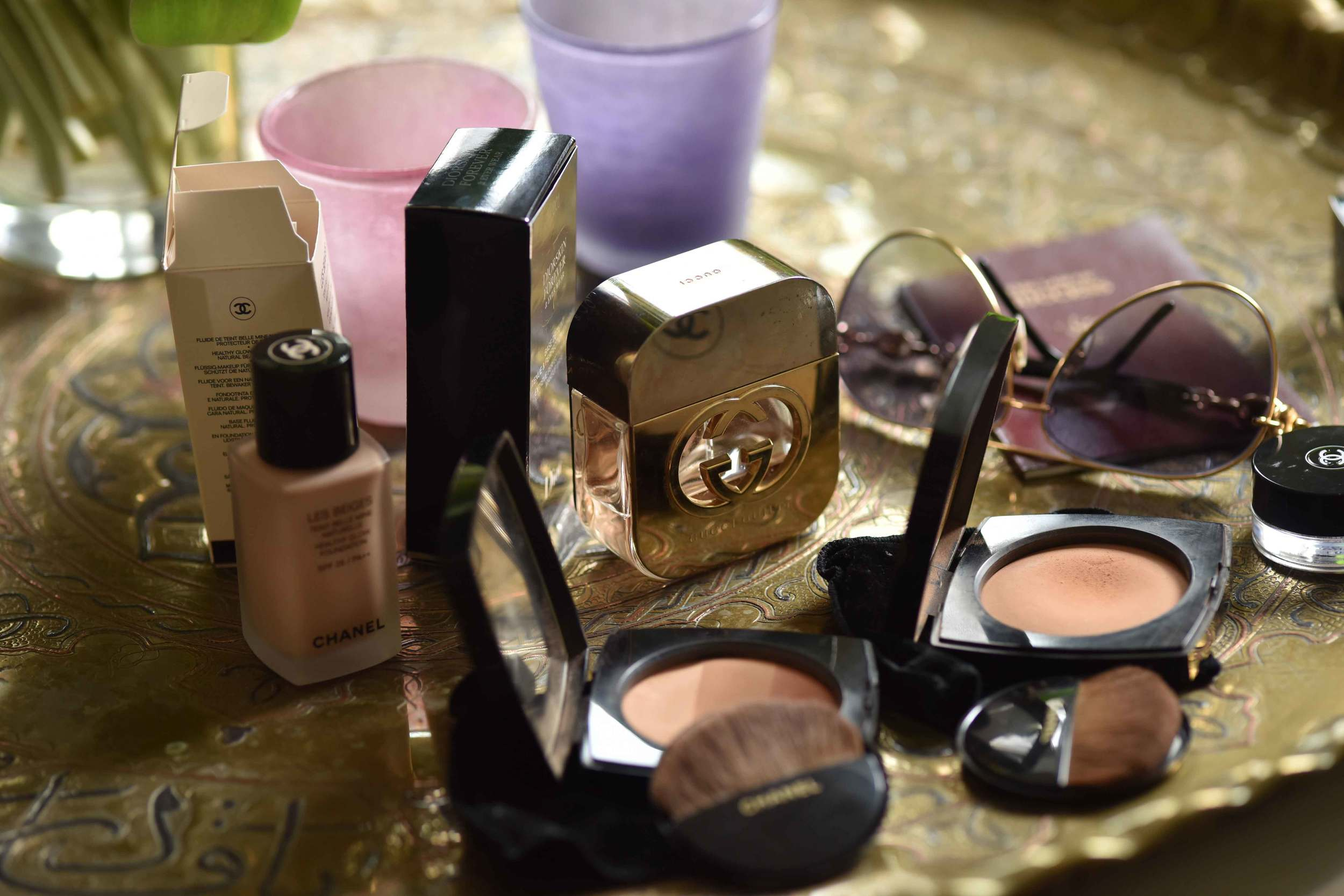 Make up from Chanel, Dior, Gucci perfume, Gucci sunglasses. Image©sourcingstyle.com, Photo: Nicola Nolting.