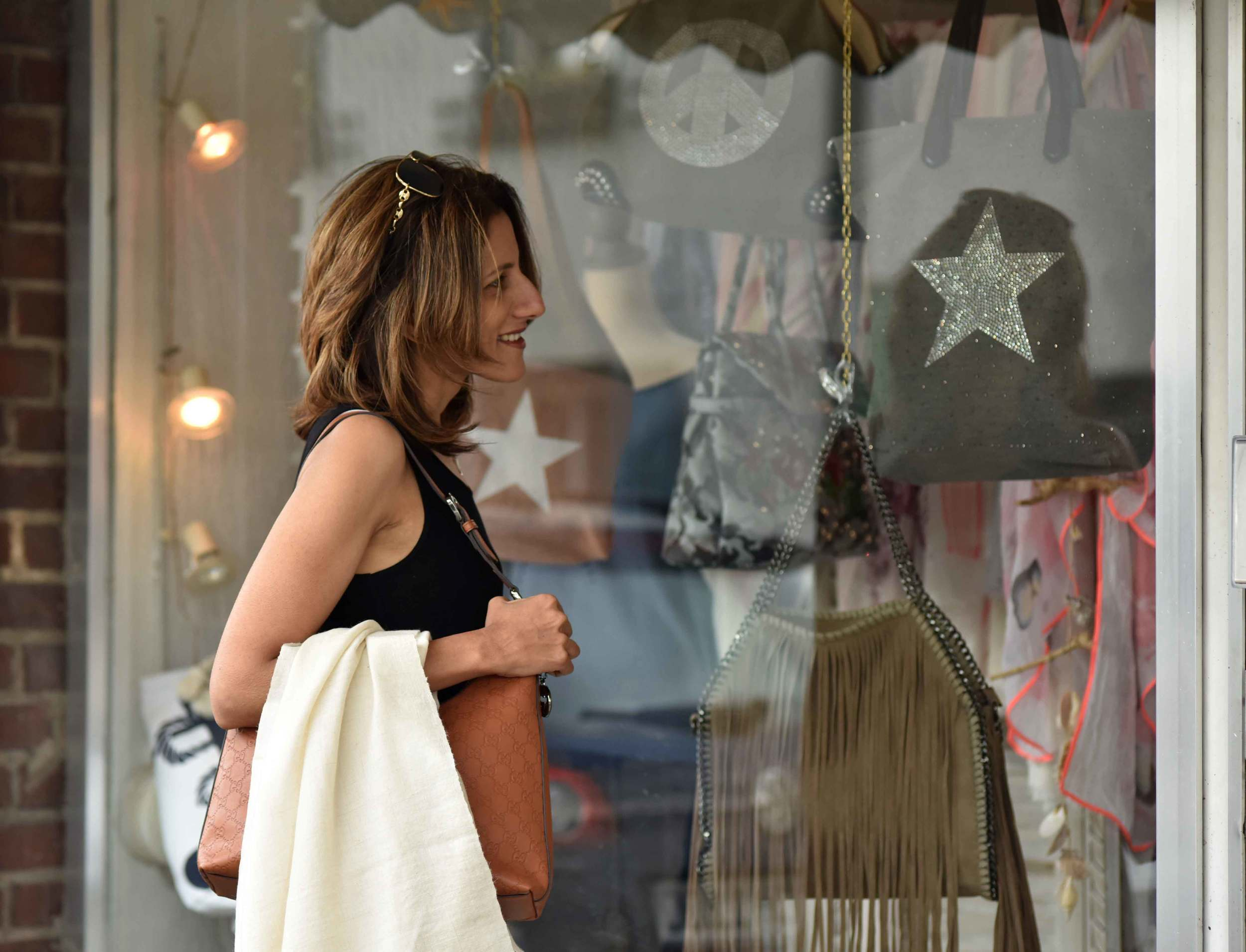 Eileen Fisher black tank dress in viscose jersey, little black dress, cashmere wrap hand-made from Kashmir, India, Gucci handbag. Image©sourcingstyle.com, Photo: Nicola Nolting.