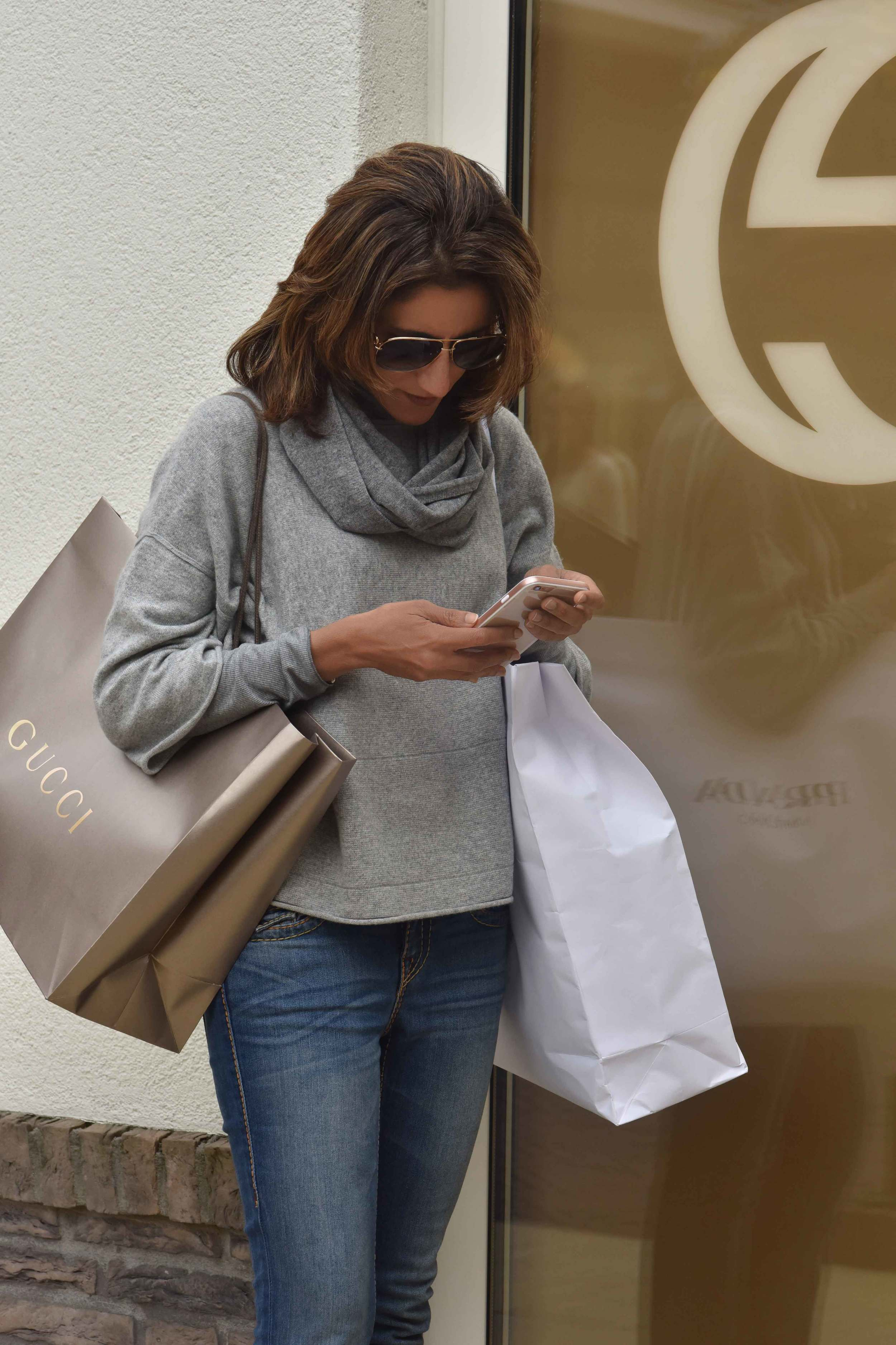 Outside Gucci store, Jjill cashmere kimono sweater, Jill cashmere infinity scarf, Designer Outlet Roermond, Netherlands. Photo: Nicola Nolting, image©sourcingstyle.com