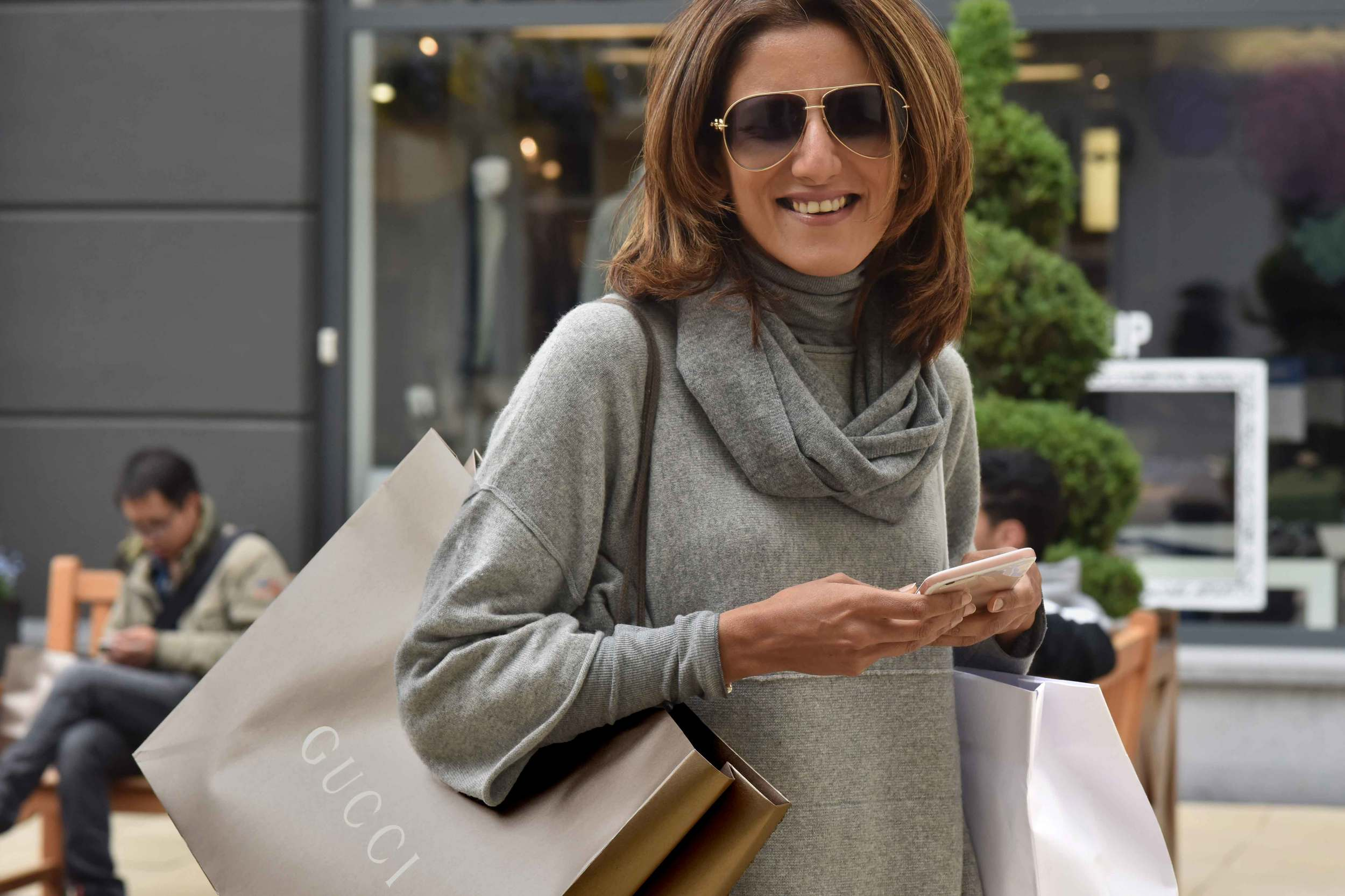 Gucci shopping bag,Jjill cashmere kimono sweater, Jill cashmere infinity scarf, Designer Outlet Roermond, Netherlands. Photo: Nicola Nolting, image©sourcingstyle.com