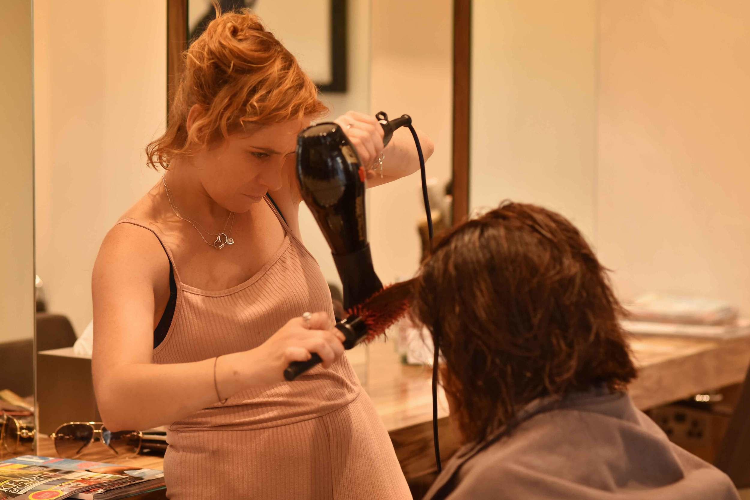 Kara Thomas, a top London hair-stylist, hair-care expert, working on my hair. Image©sourcingstyle.com