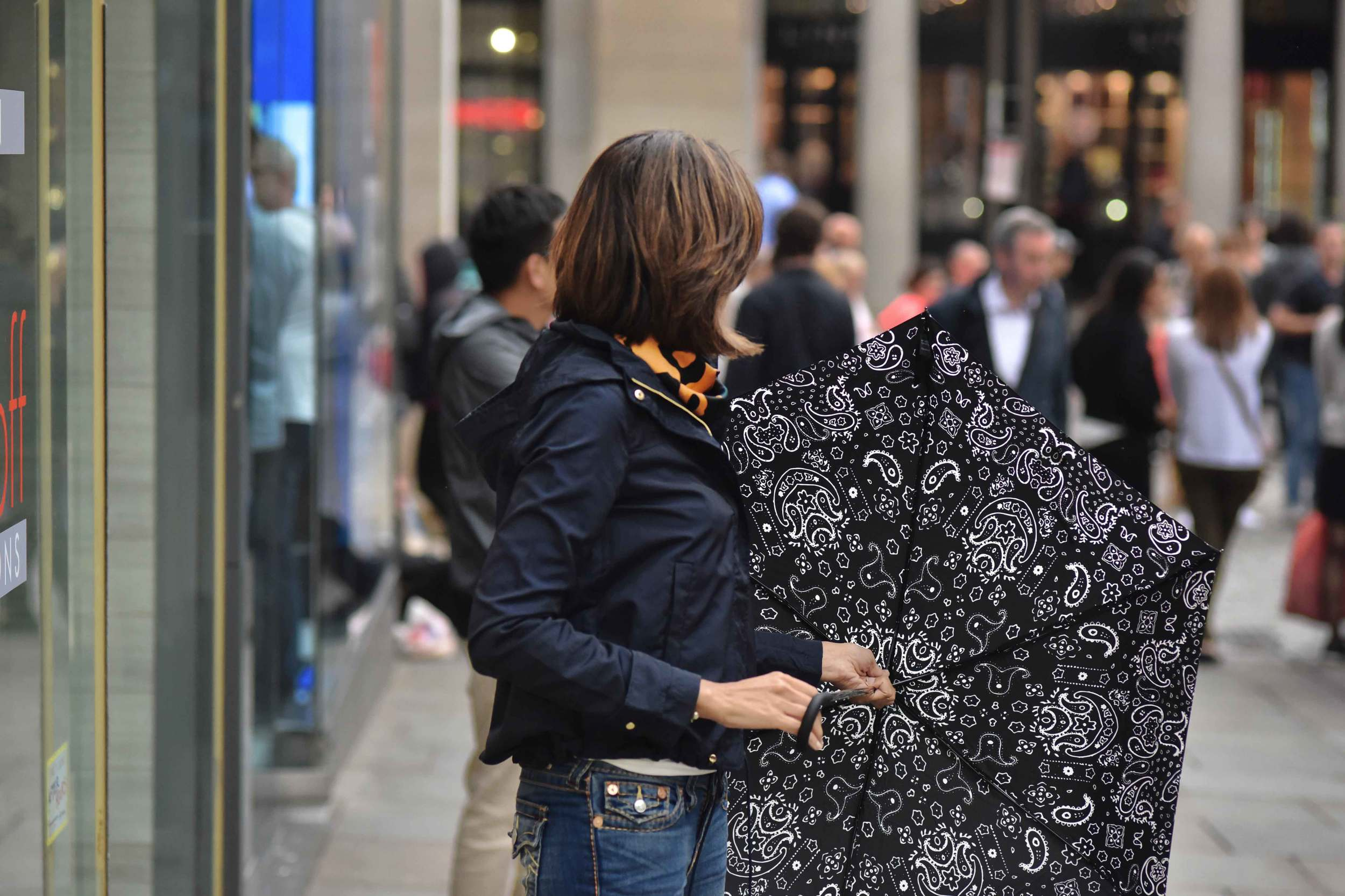 Zara water repellent jacket, Zara printed pocket square, Zara bandana print umbrella, True Religion jeans, Covent Garden, London, UK. Image©sourcingstyle.com