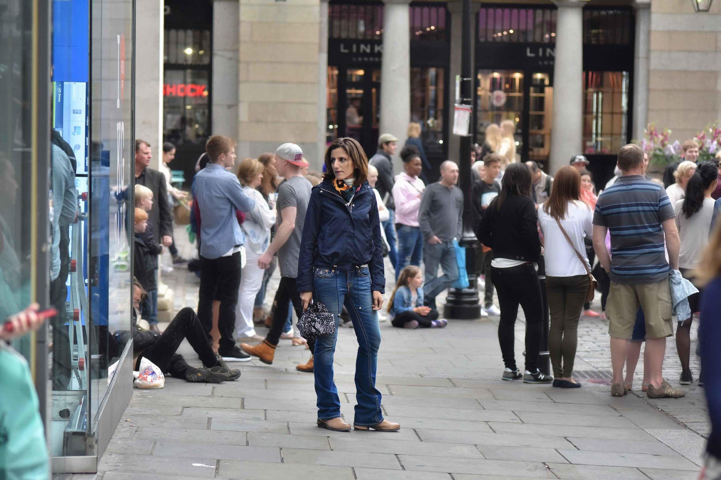 Zara water repellent jacket, Zara printed pocket square, Zara bandana print umbrella, True Religion jeans, Uggs boots, Covent Garden, London, UK. Image©sourcingstyle.com