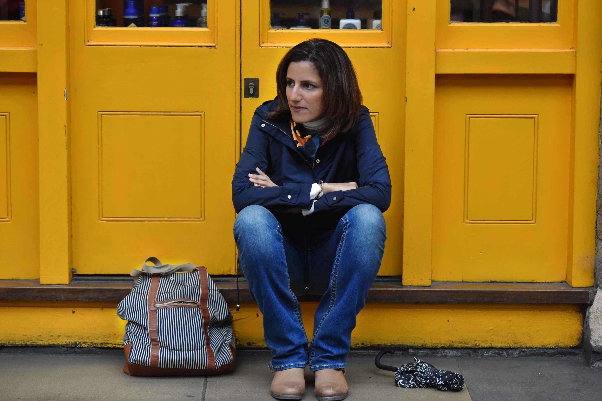 Zara water repellent jacket, Zara printed pocket square, Zara bandana print umbrella, True Religion jeans, Uggs boots, Apple Market, Covent Garden, London, UK. Image©sourcingstyle.com