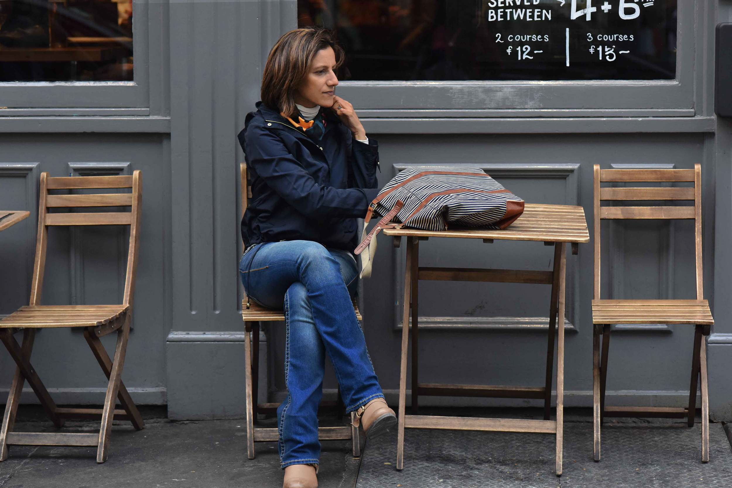 Zara water repellent jacket, Ralph Lauren polo sweater, Zara printed pocket square, Zara bandana print umbrella, True Religion jeans, Uggs boots, Covent Garden, London, UK. Image©sourcingstyle.com