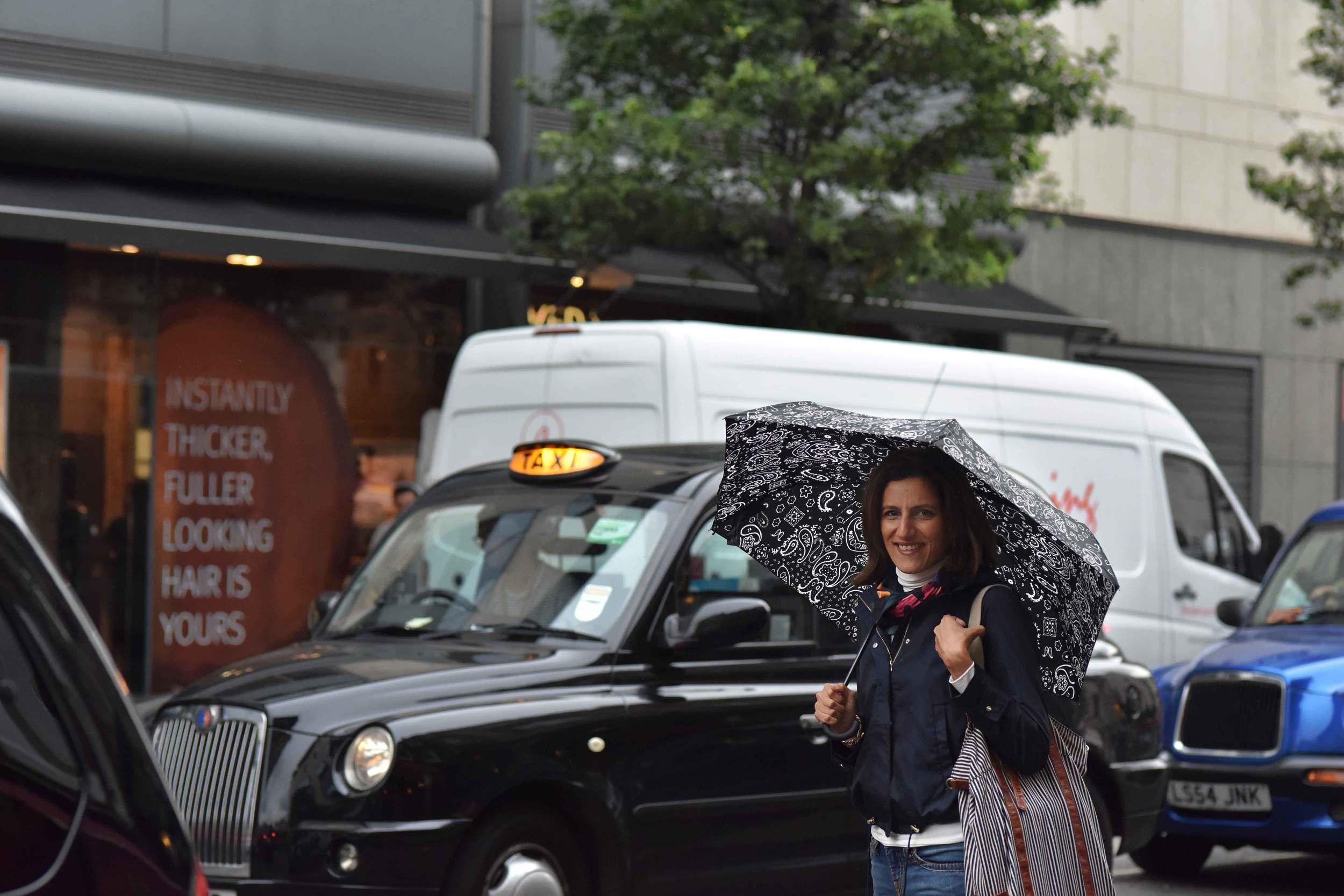 Zara water repellent jacket, Ralph Lauren polo sweater, Zara printed pocket square, Zara bandana print umbrella, True Religion jeans, a London cab, Covent Garden, London, UK. Image©sourcingstyle.com