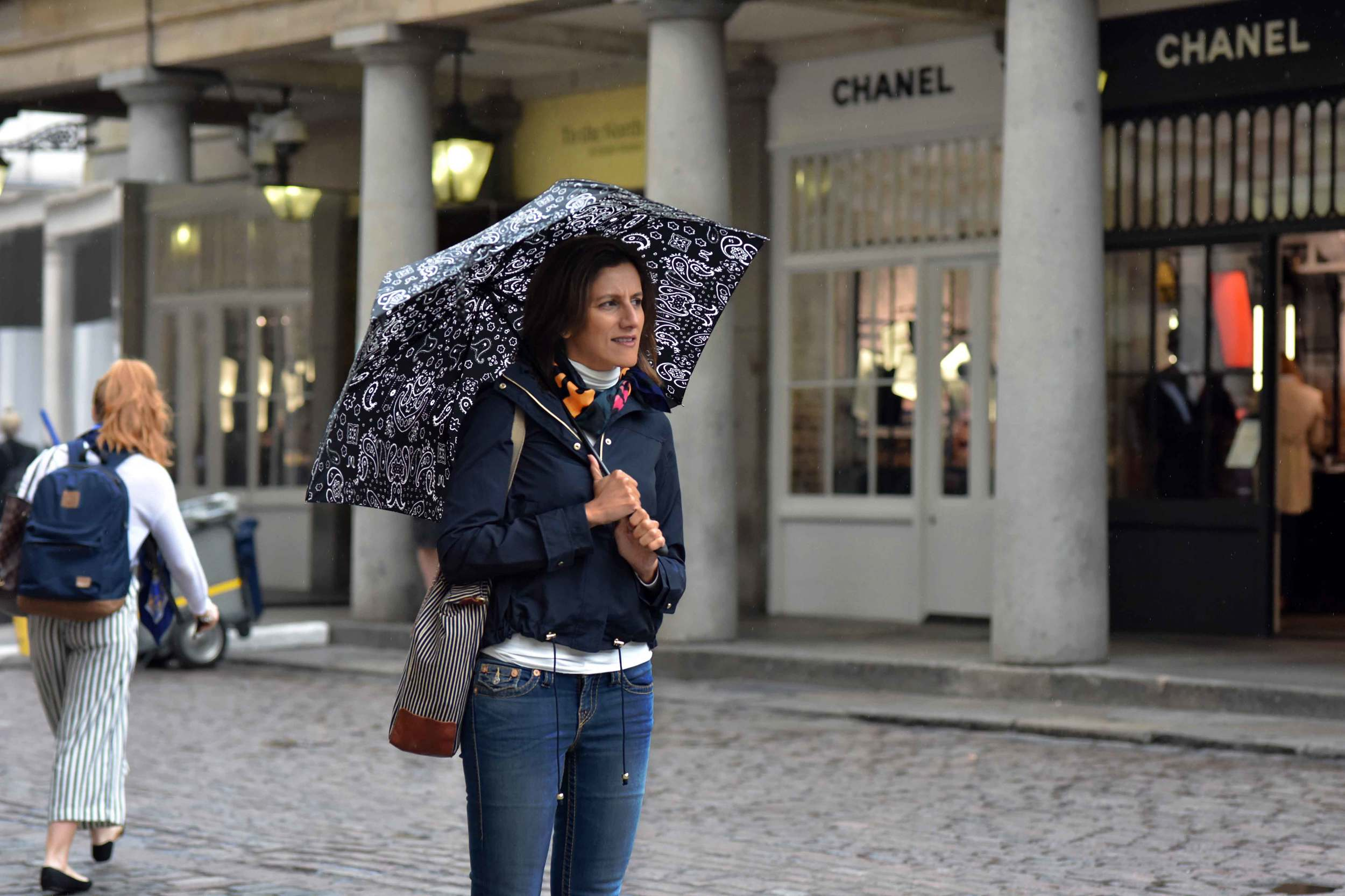 Zara water repellent jacket, Ralph Lauren polo sweater, Zara printed pocket square, Zara bandana print umbrella, True Religion jeans, Covent Garden, London, UK. Image©sourcingstyle.com