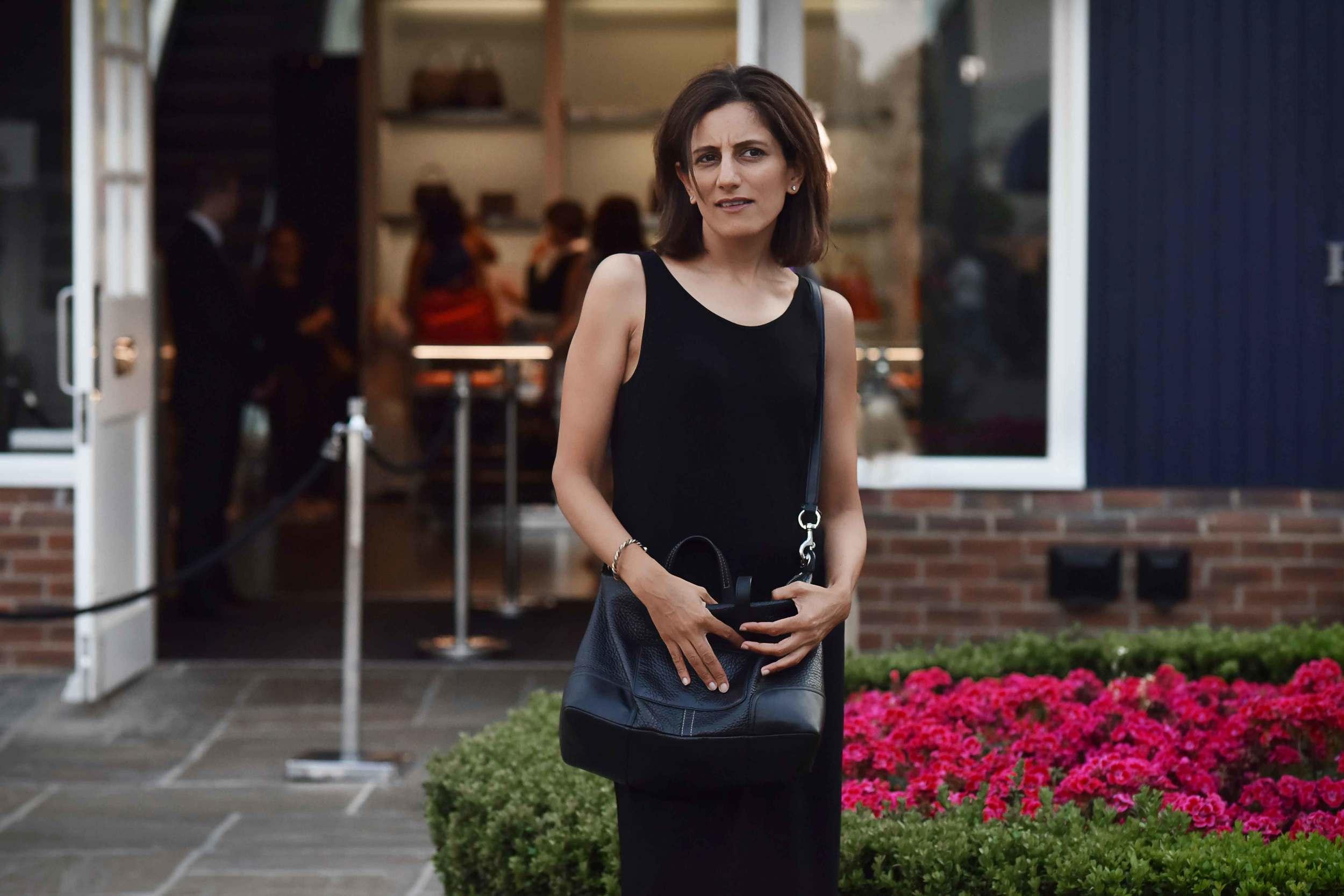Eileen Fisher jersey black tank dress, Coach crossbody bag, Bicester Village. Image©sourcingstyle.com